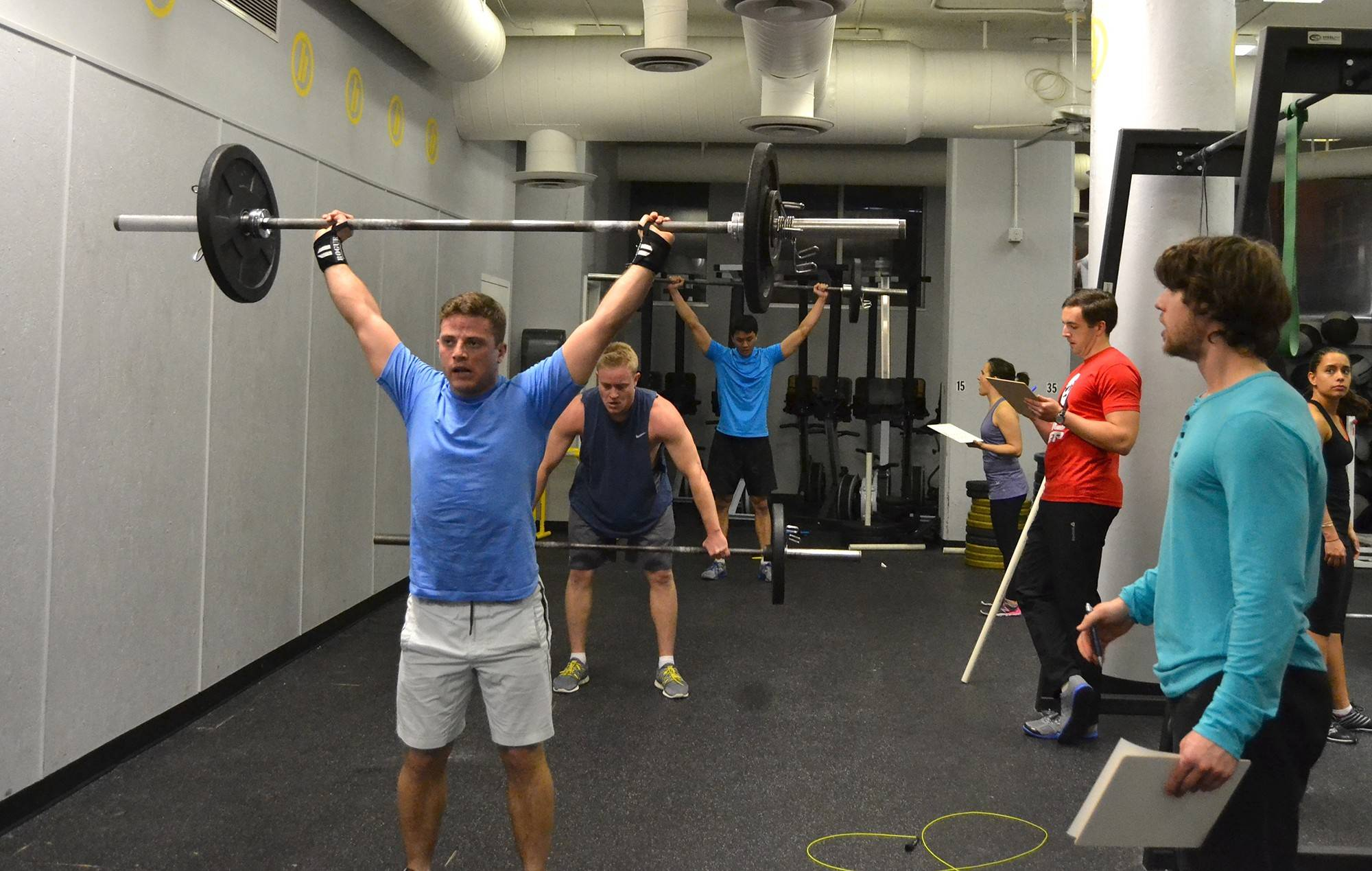 Joseph Cofrancesco, front, and others lift under the supervision of judges at CrossFit Balance in Washington.