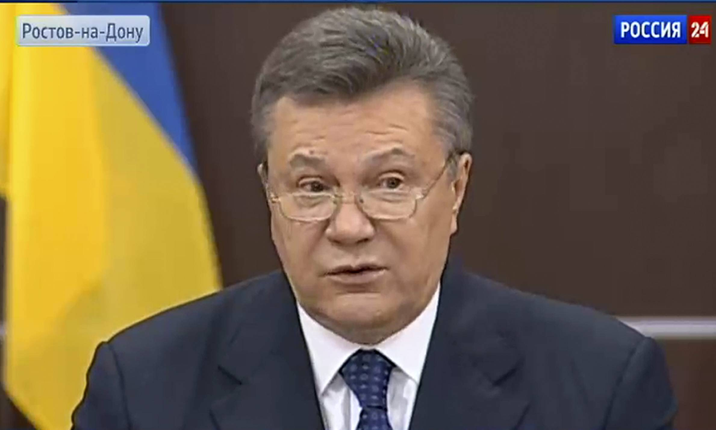 Ukraine's fugitive president, Viktor Yanukovych, speaking on Russian state television Sunday, accused the American CIA of being behind the new Ukrainian government's decision to deploy armed forces to quash an increasingly brazen pro-Russian insurgency.