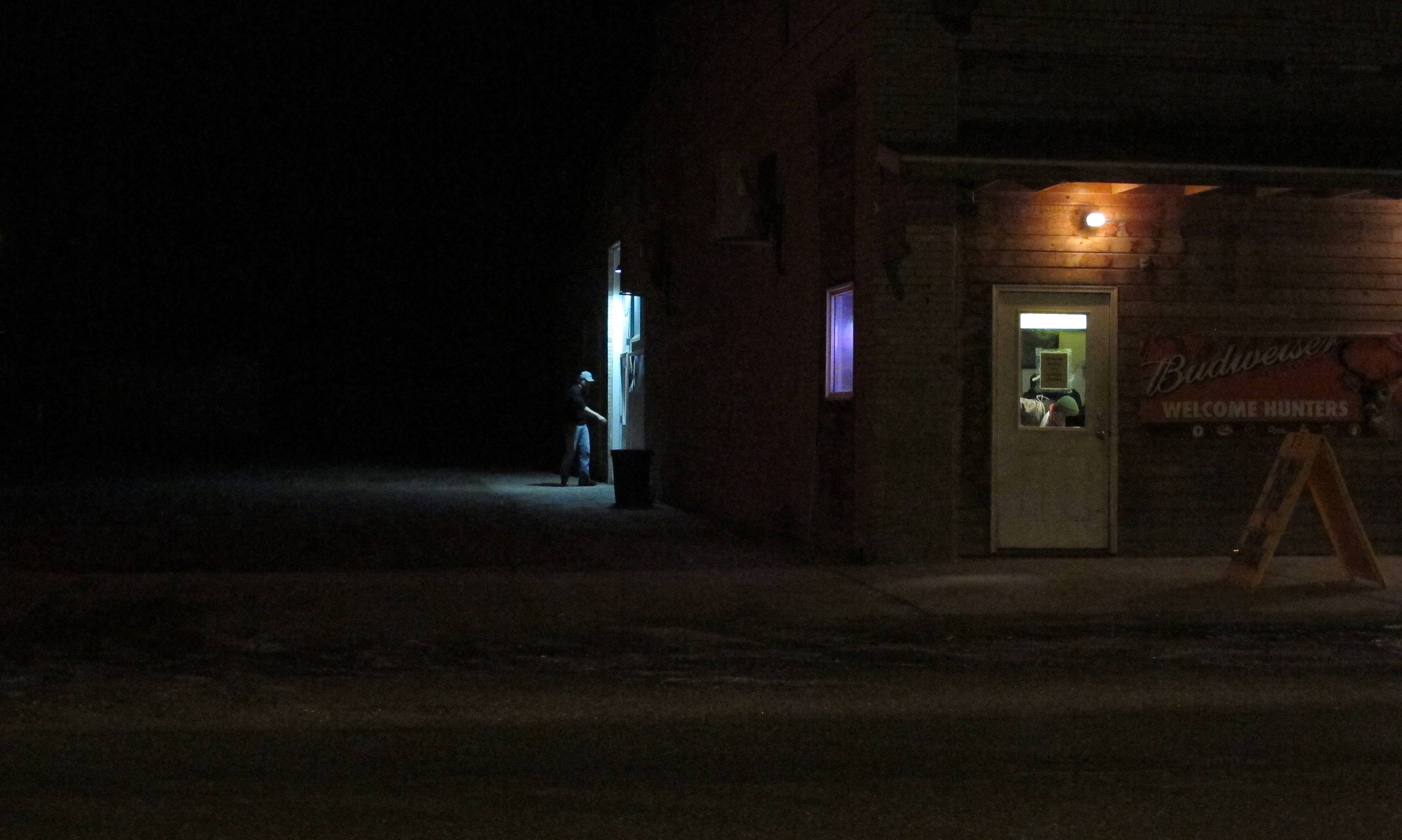 A patron walks into a bar in Alexander, N.D. The Baaken region, which includes northwest North Dakota, is known for its night life and drinking scene. Law enforcement officials say the region has had a growing crime problem, much of it related to drug and alcohol abuse. (AP Photo/Martha Irvine)