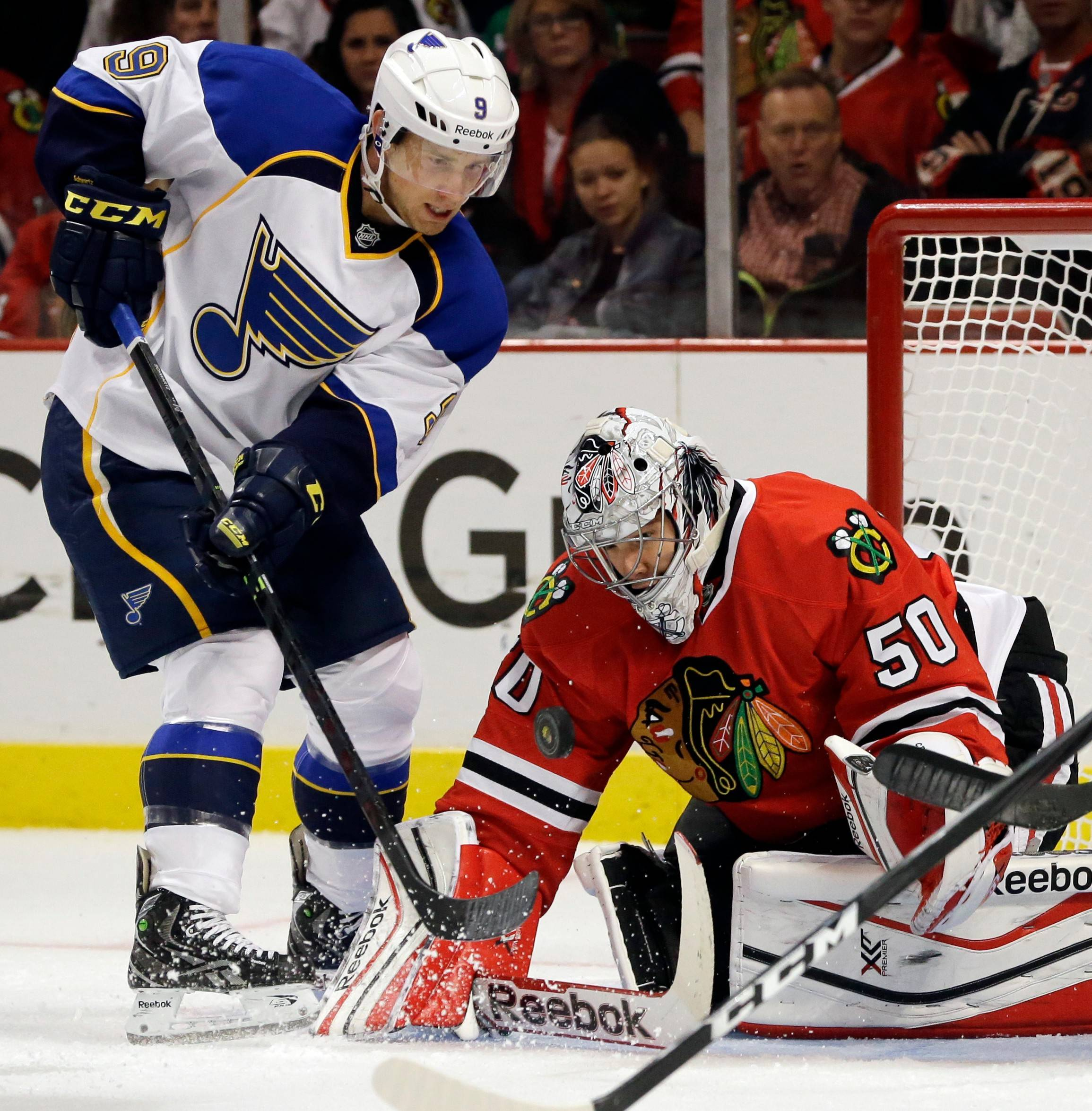 Blackhawks goalie Corey Crawford blocks a shot by the St. Louis Blues' Jaden Schwartz in a game from last October. The Hawks and Blues will face each other in the first round of the playoffs, beginning Thursday.