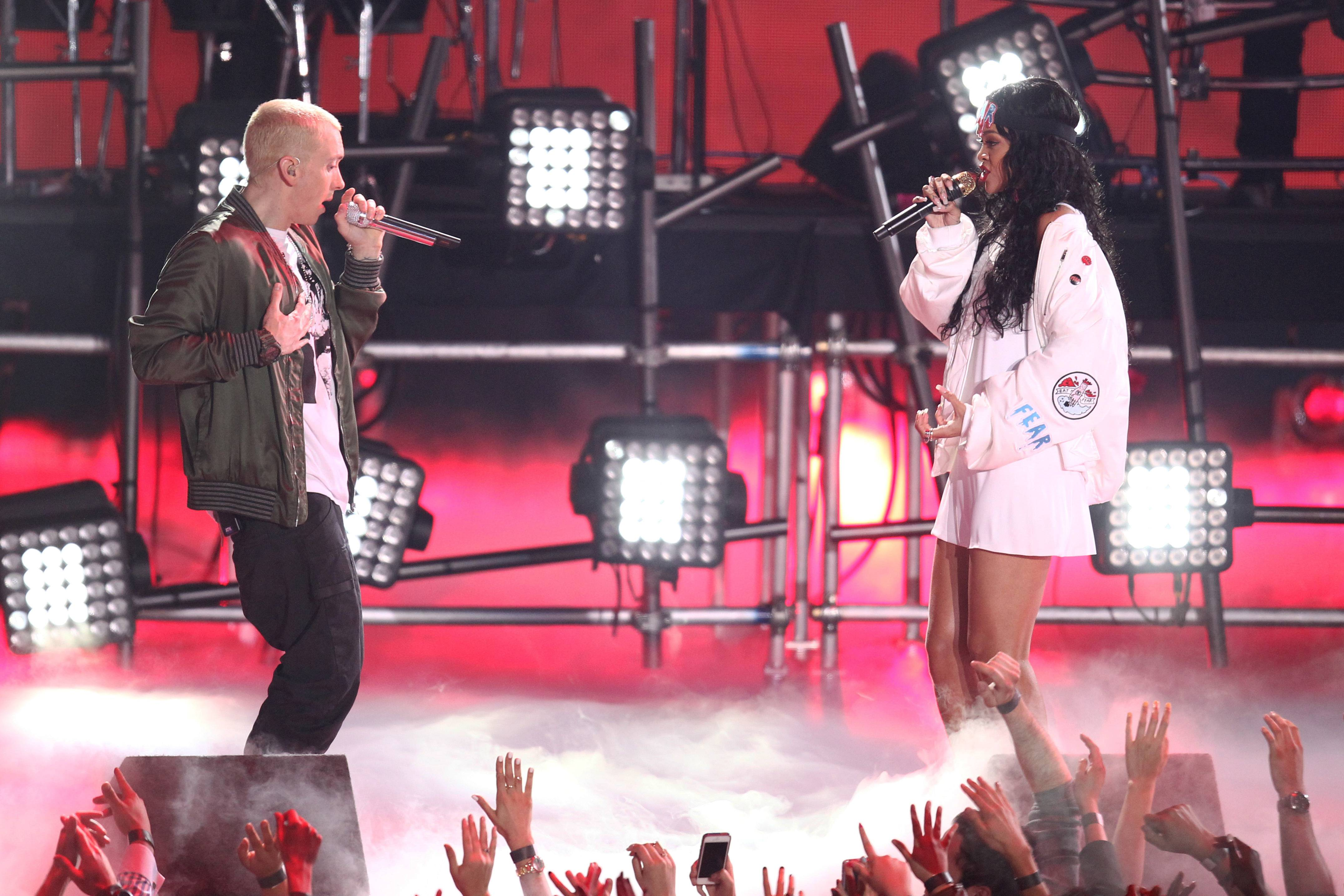 Eminem, left, and Rihanna perform on stage at the MTV Movie Awards on Sunday at Nokia Theatre in Los Angeles.