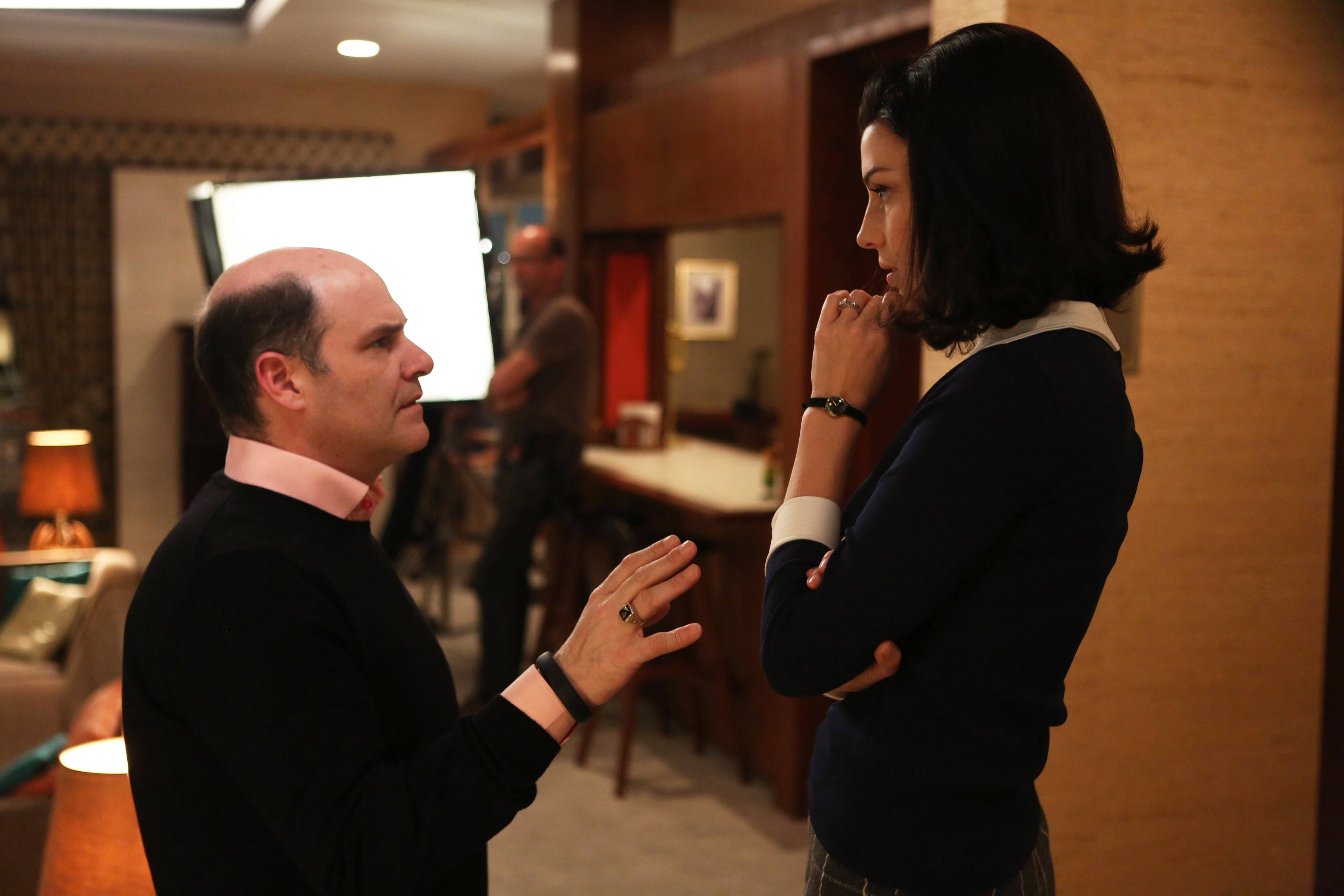 """Mad Men"" creator Matthew Weiner, left, talks with actress Jessica Pare on the set of the AMC TV series. Weiner, as the auteur of the landmark drama series, voices both resolve and wonderment at his task of bringing ""Mad Men"" in for a landing. The final season begins at 9 p.m. Sunday."
