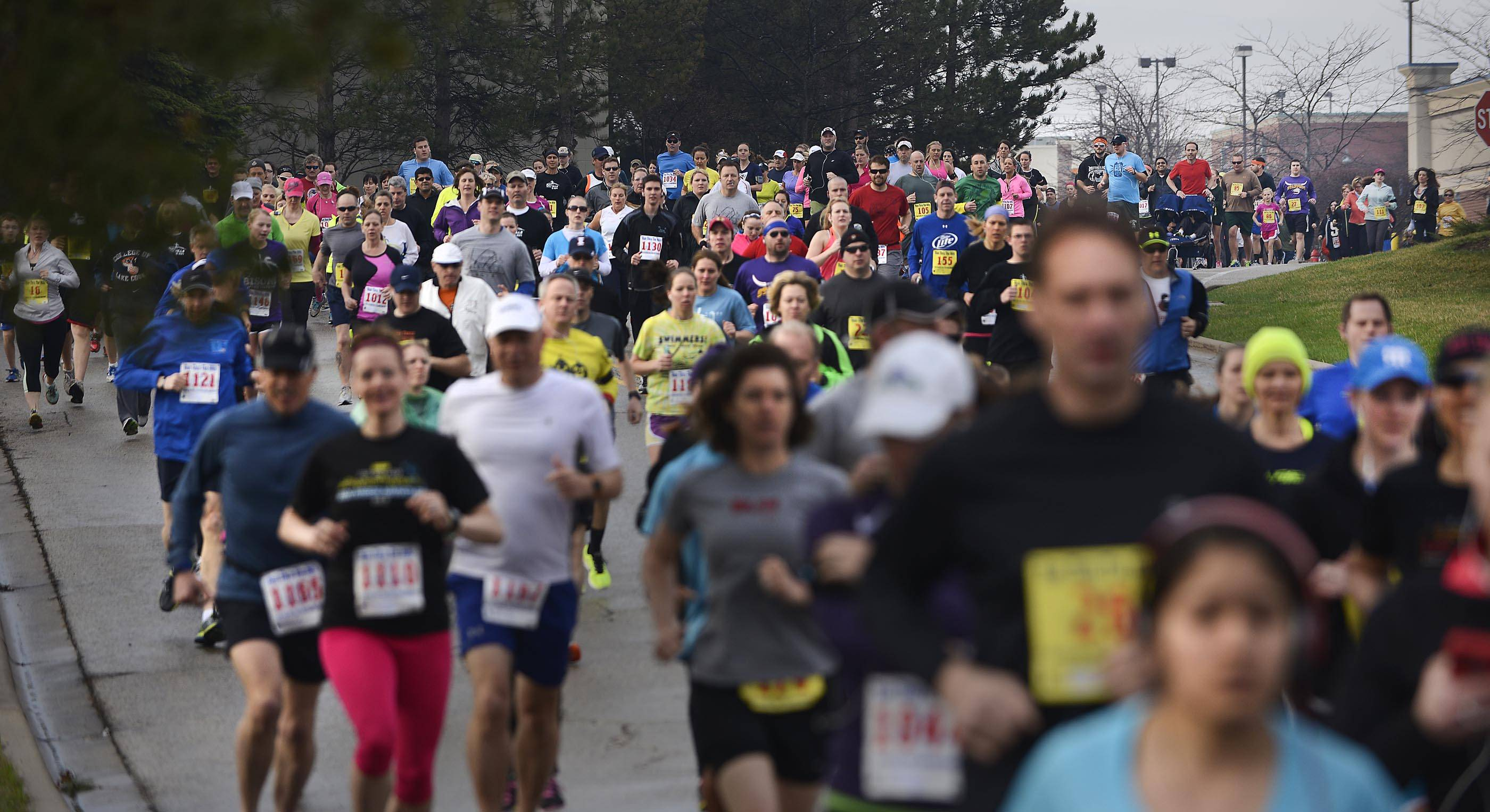 Runners fill the road Sunday morning at the start at the 15th Run Thru The Hills 5K and 10K races in Lake in the Hills. About 500 runners took part in the races.