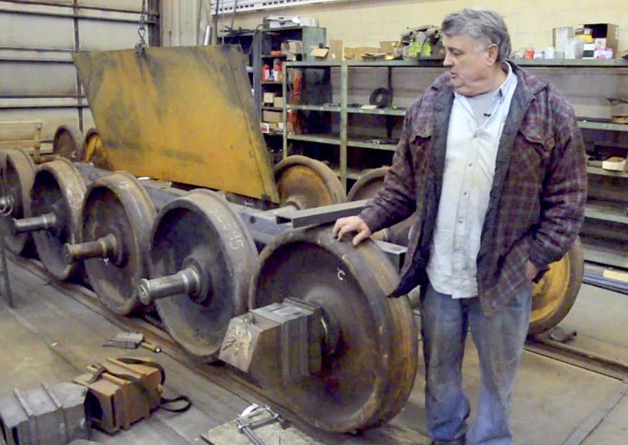 David H. Kloke, master mechanic and owner of Kloke Construction and Kloke Locomotive Works LLC, in Elgin, talks about the wheel sets for the replica Lincoln funeral train he is building.