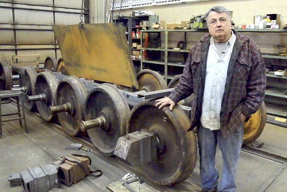 David H. Kloke, master mechanic and owner of Kloke Construction and Kloke Locomotive Works LLC, in Elgin, talks about the wheel sets for the replica Lincoln funeral train car he is building.