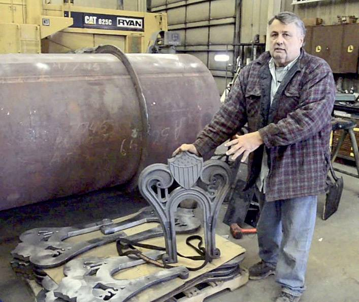 David H. Kloke, master mechanic and owner of Kloke Construction and Kloke Locomotive Works LLC, in Elgin, shows some of the car pedestals he created for a replica of Abraham Lincoln's funeral train car.