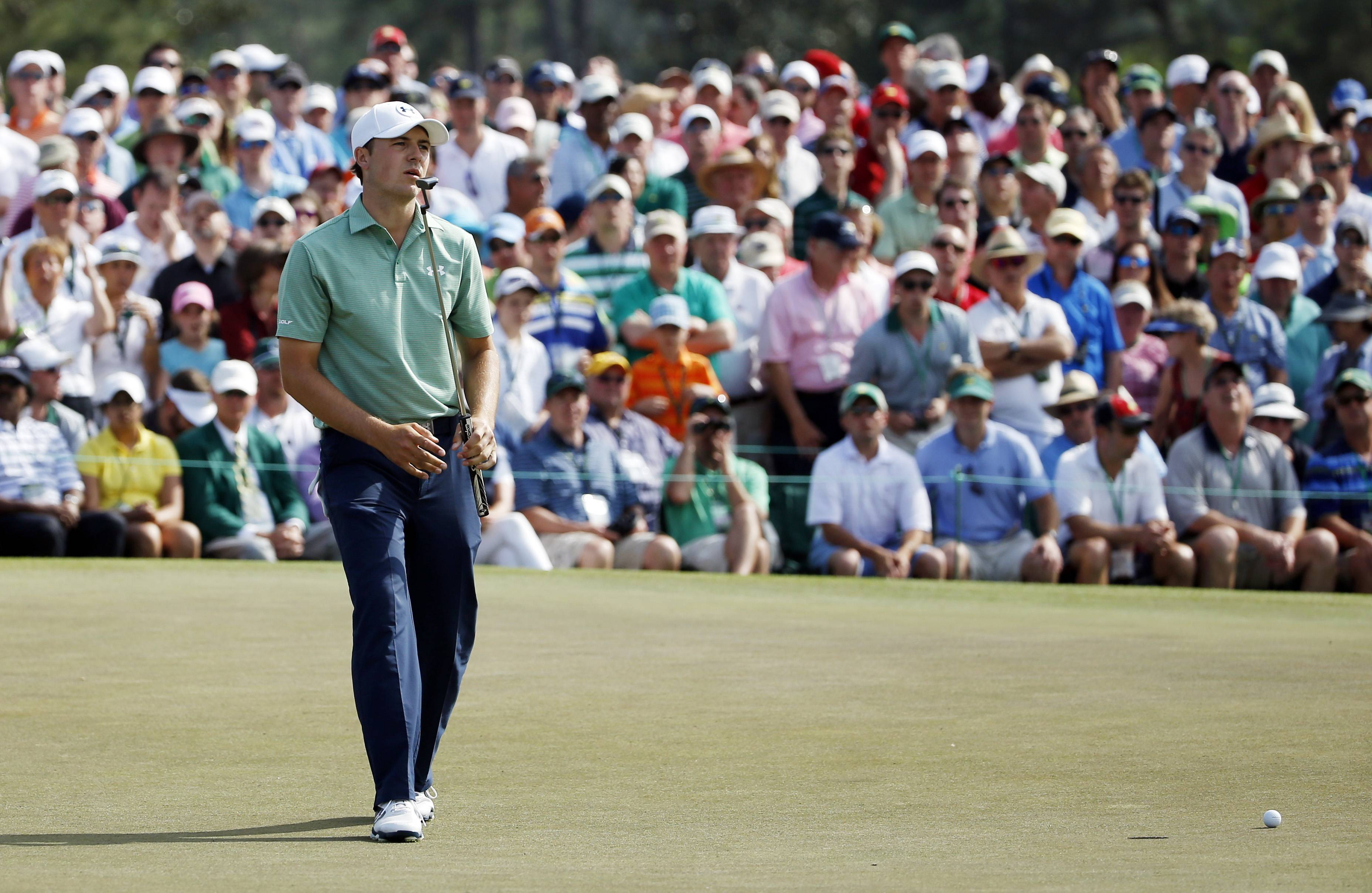 Jordan Spieth reacts as his ball misses the cup on the ninth hole in Sunday's final round of the Masters.