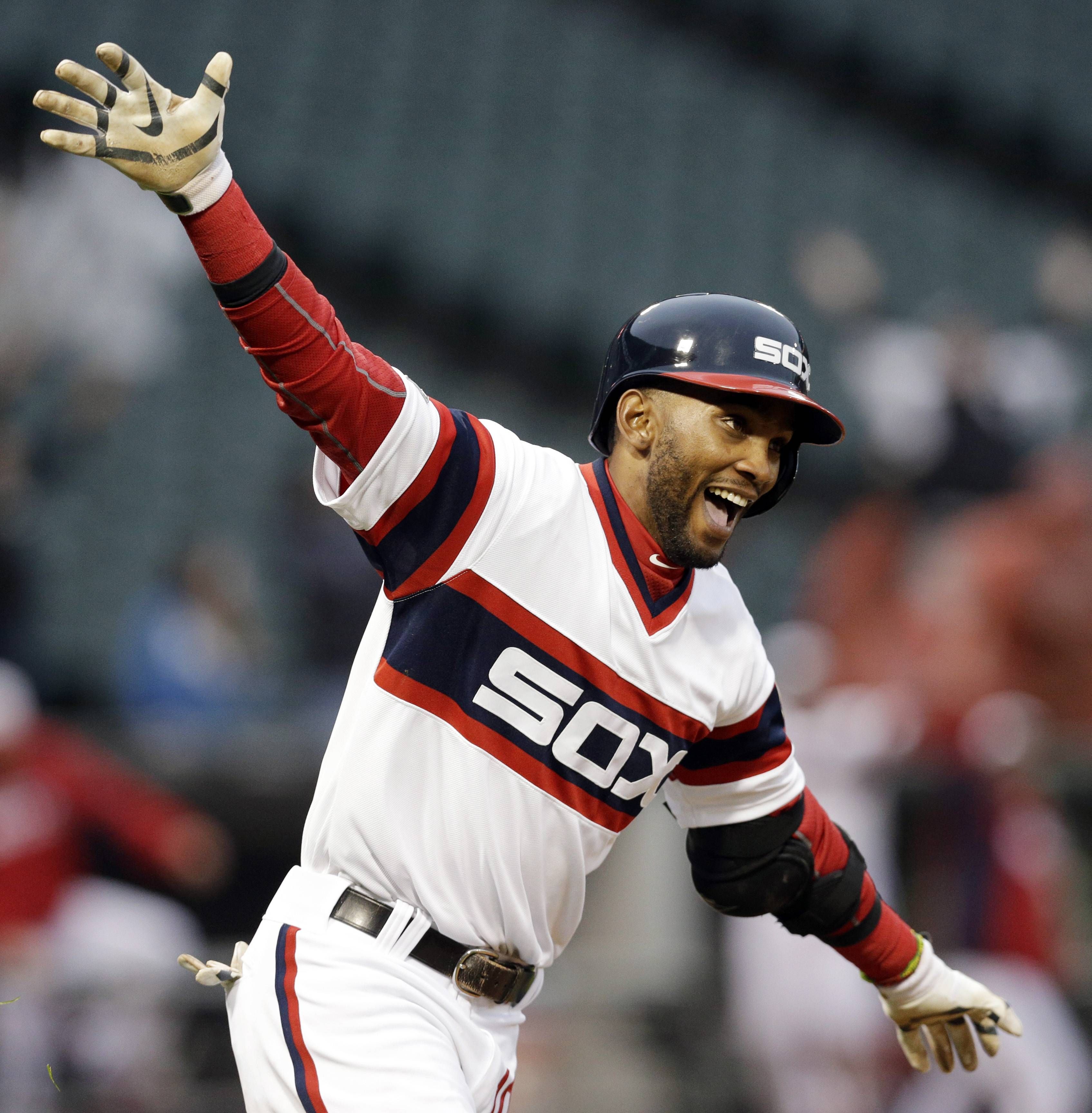 Chicago White Sox's Alexei Ramirez celebrates as he rounds the bases after hitting the game-winning two-run home run during the ninth inning of a baseball game against the Cleveland Indians in Chicago on Sunday, April 13, 2014. The White Sox won 4-3.