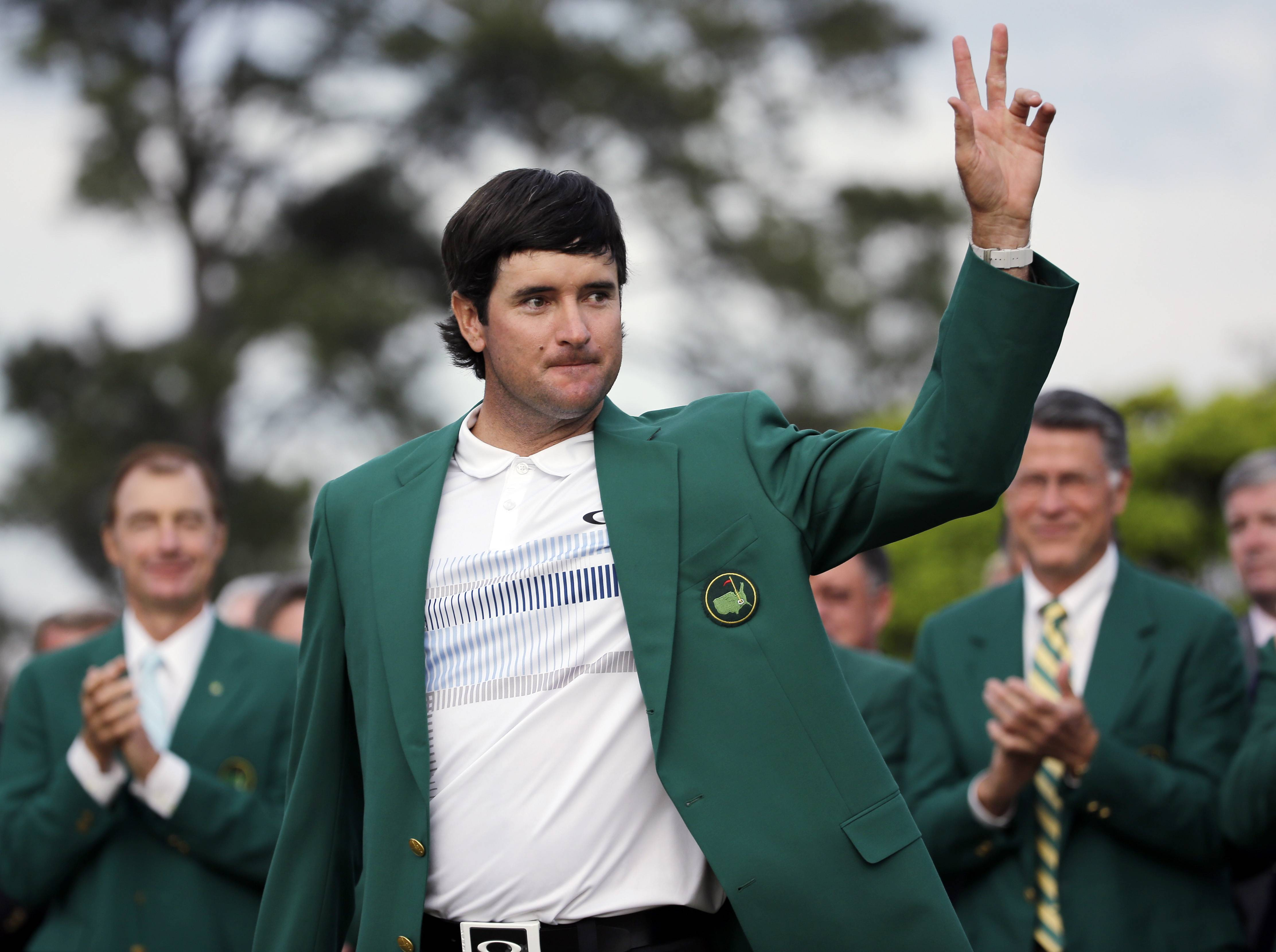Bubba Watson waves after being presented with his green jacket after winning the Masters golf tournament Sunday, April 13, 2014, in Augusta, Ga.