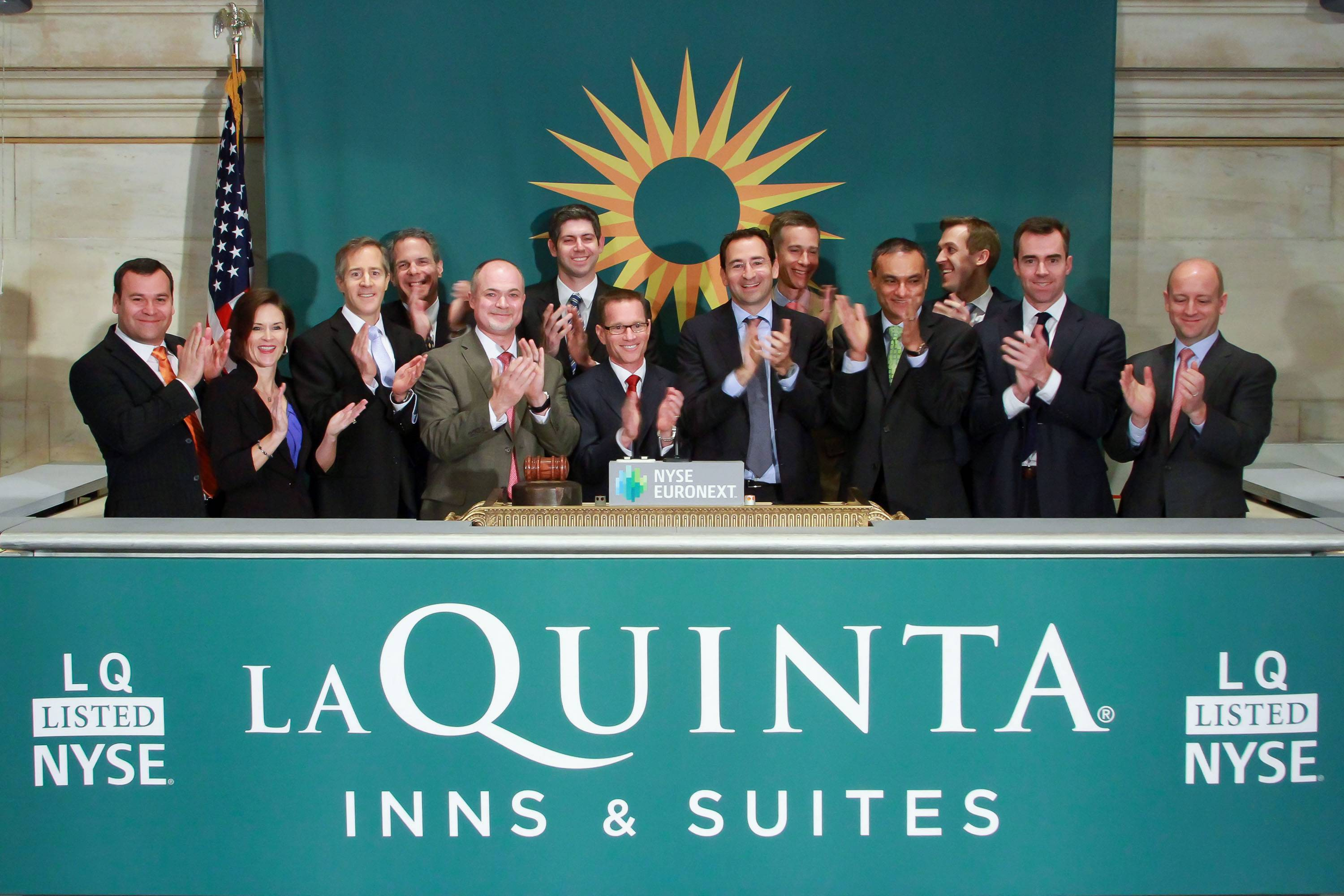 Executives and guests of La Quinta Holdings applaud the opening bell at the New York Stock Exchange on April 9, in honor of the company's IPO.