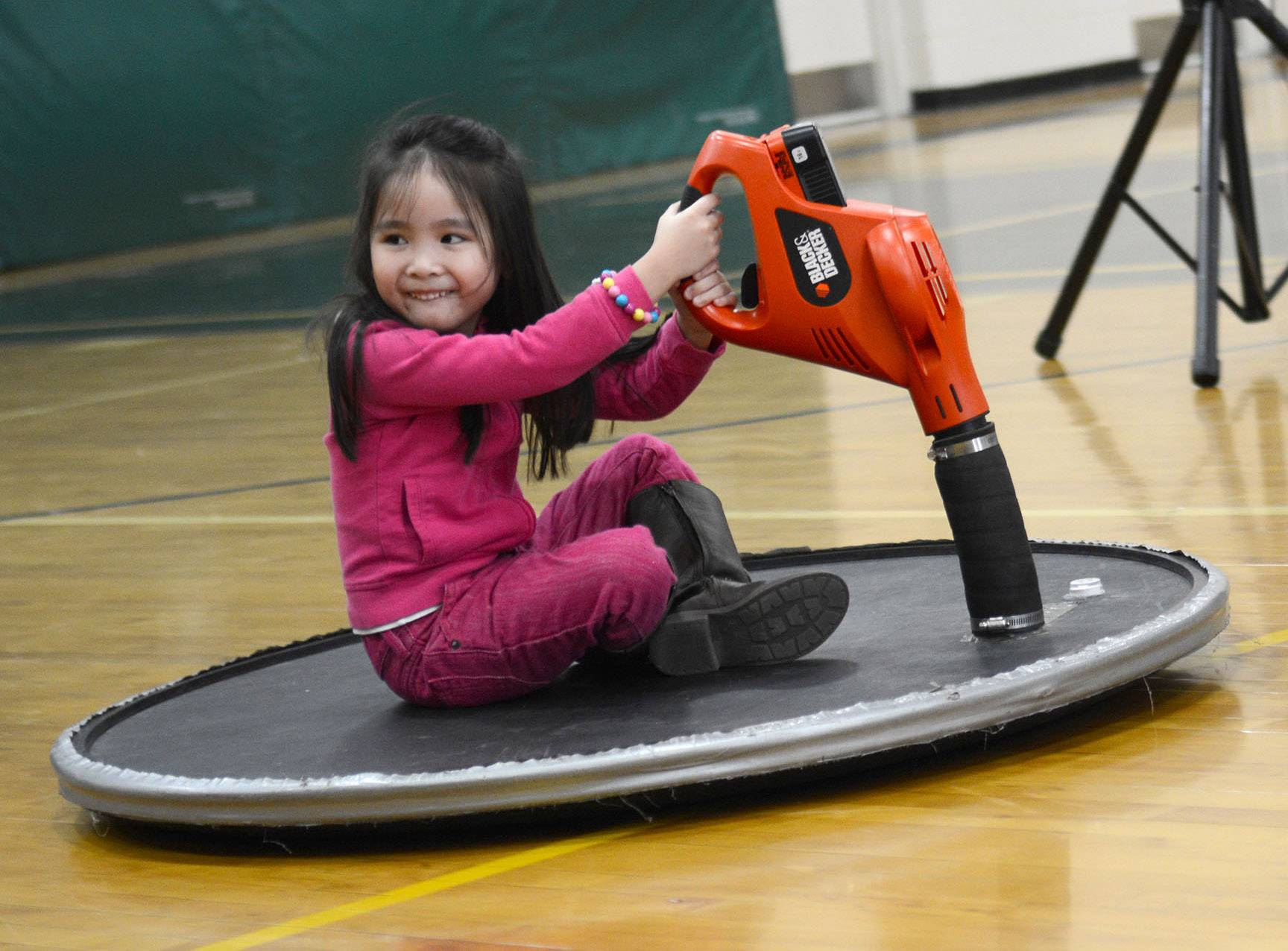 Fremont kindergarten student Gian Naval Vales hovers over the gymnasium floor during a Getting Excited about Science assembly.