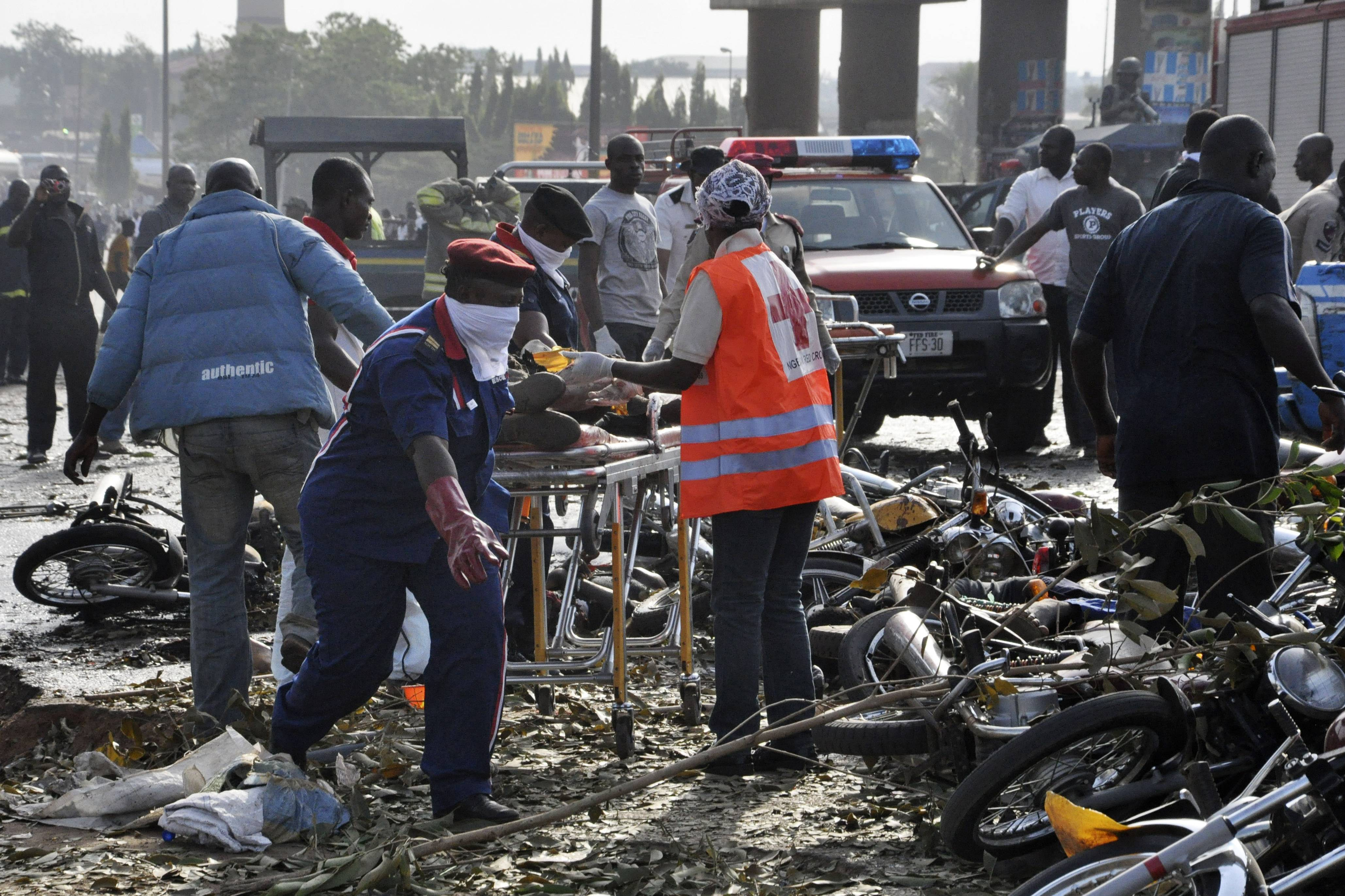 Rescue workers work Monday to recover victims at the worst-ever bomb attack on Nigeria's capital of Abuja. The attack killed at least 72 people.