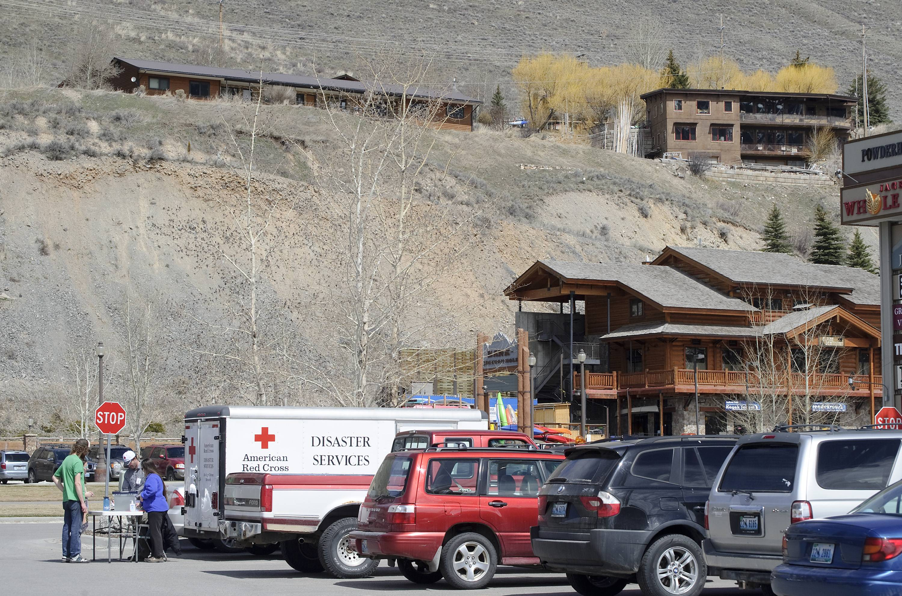 Displaced residents of Budge Drive in Jackson, Wyo., register with the American Red Cross on Thursday, as geologists study a hillside where the potential for a landslide called for an evacuation.