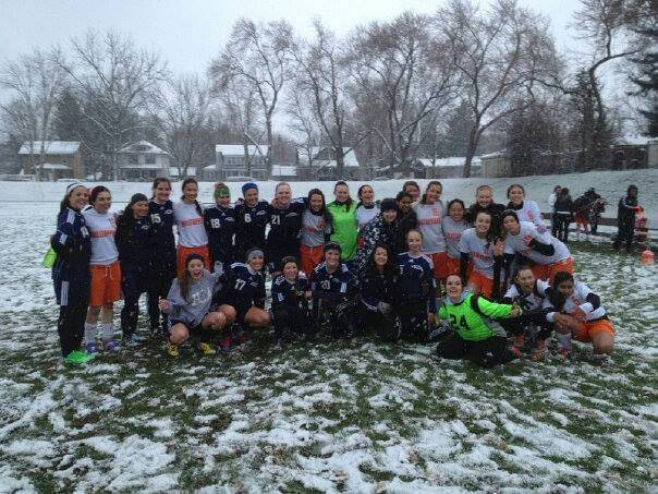 The girls soccer teams from Harvest Christian Academy and Elgin Academy gather for a photo after their game in Elgin Monday, played through a mid-April snow. Harvest won 5-1.