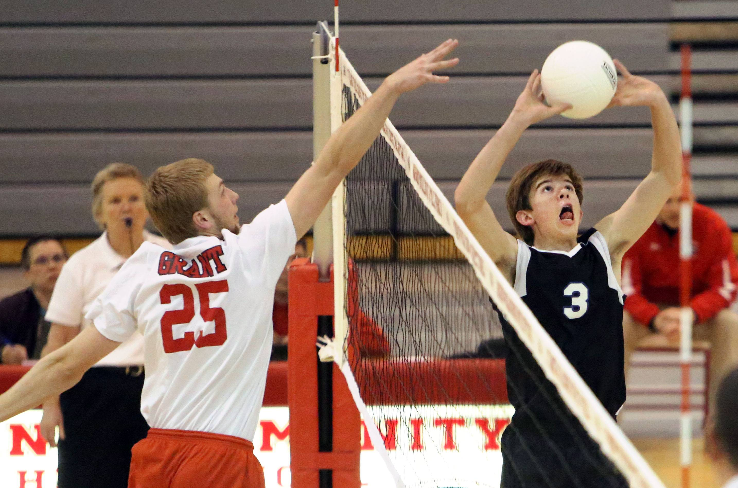 Grant's Mitch Meier, left and Lake Zurich's Pat Bush meet at the net Monday at Grant.