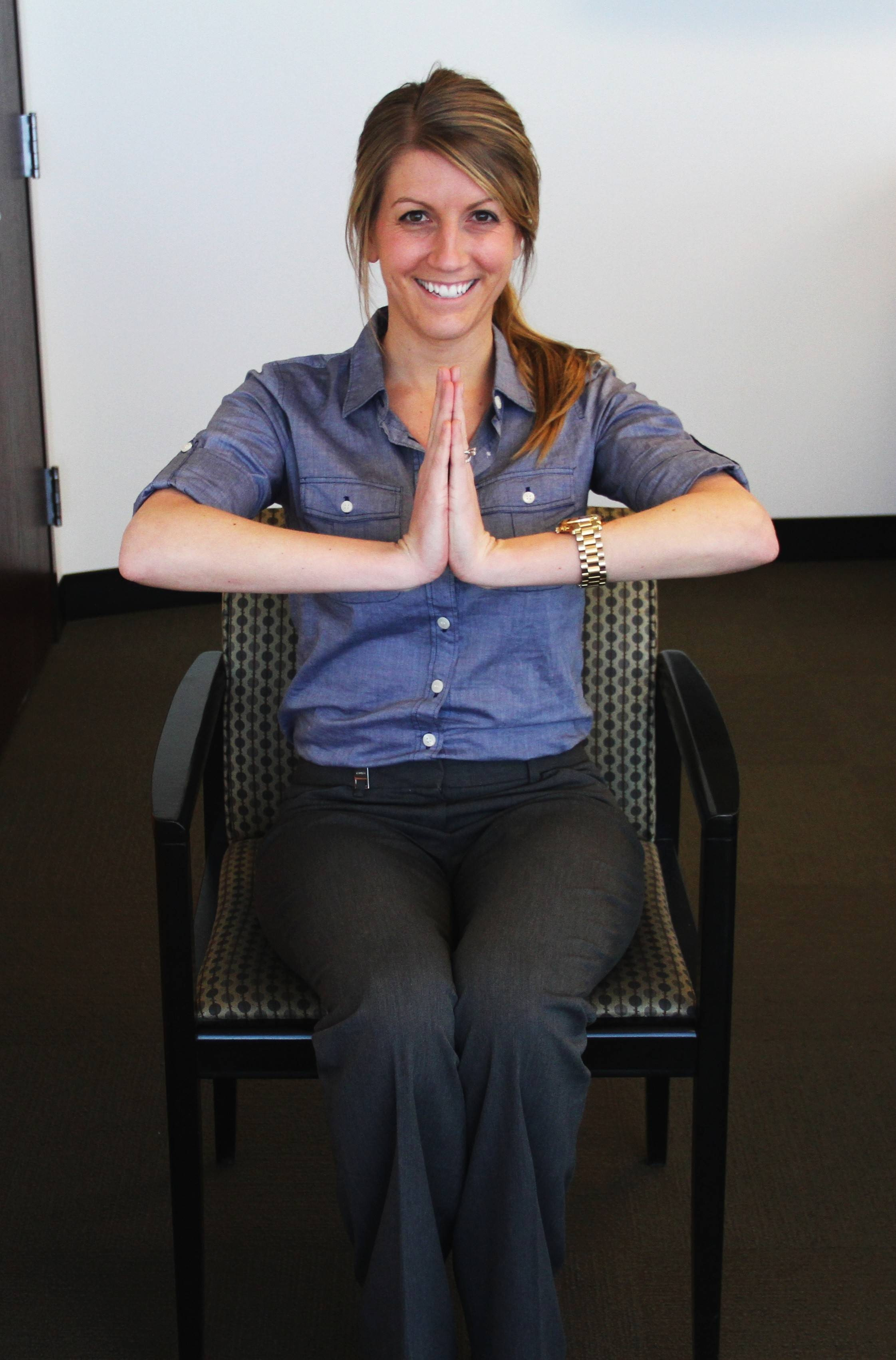 Jill Micklow, Wellness Specialist at Assurance, demonstrates an at-work yoga pose that works your mind and your arms.