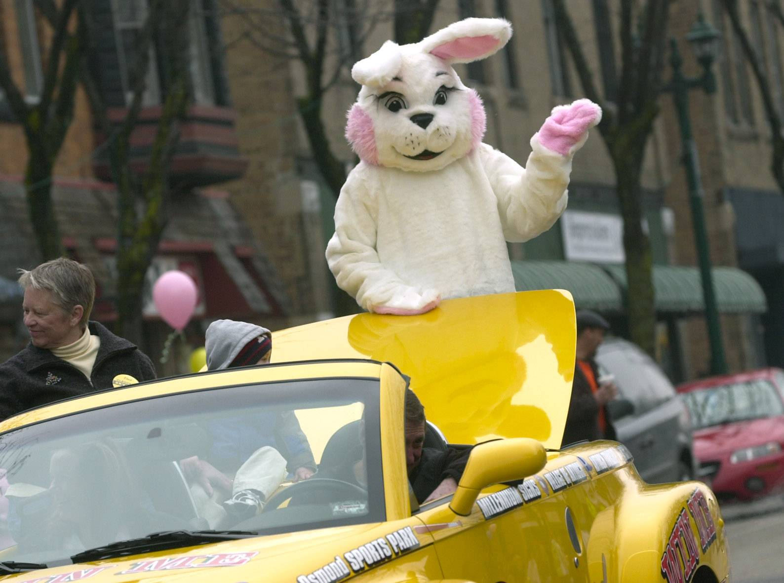 The Easter Bunny waives to children during a previous Easter parade through downtown Antioch.