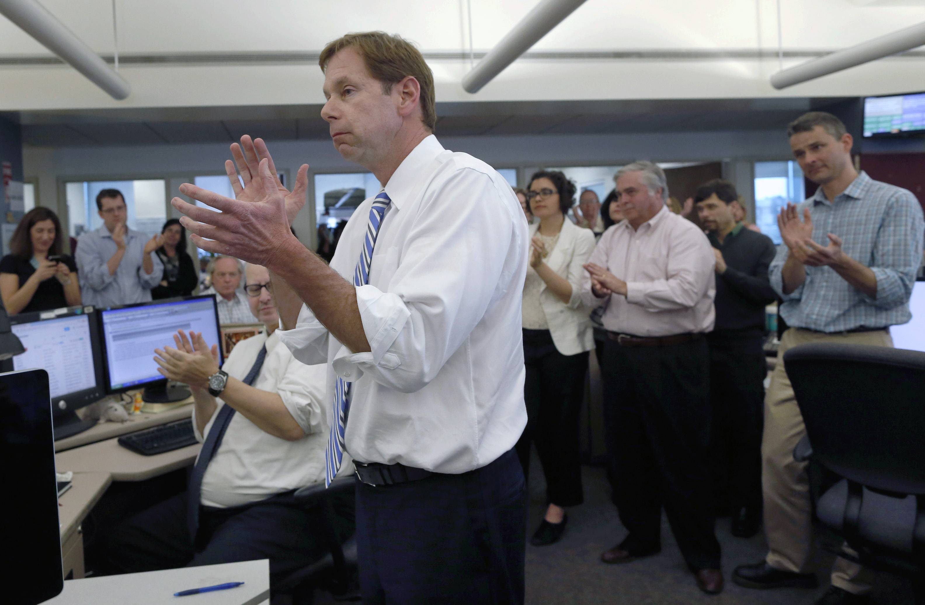 Editor Brian McGrory and members of the newsroom applaud after The Boston Globe was awarded the Pulitzer Prize for breaking news for coverage of the 2013 Boston Marathon bombings