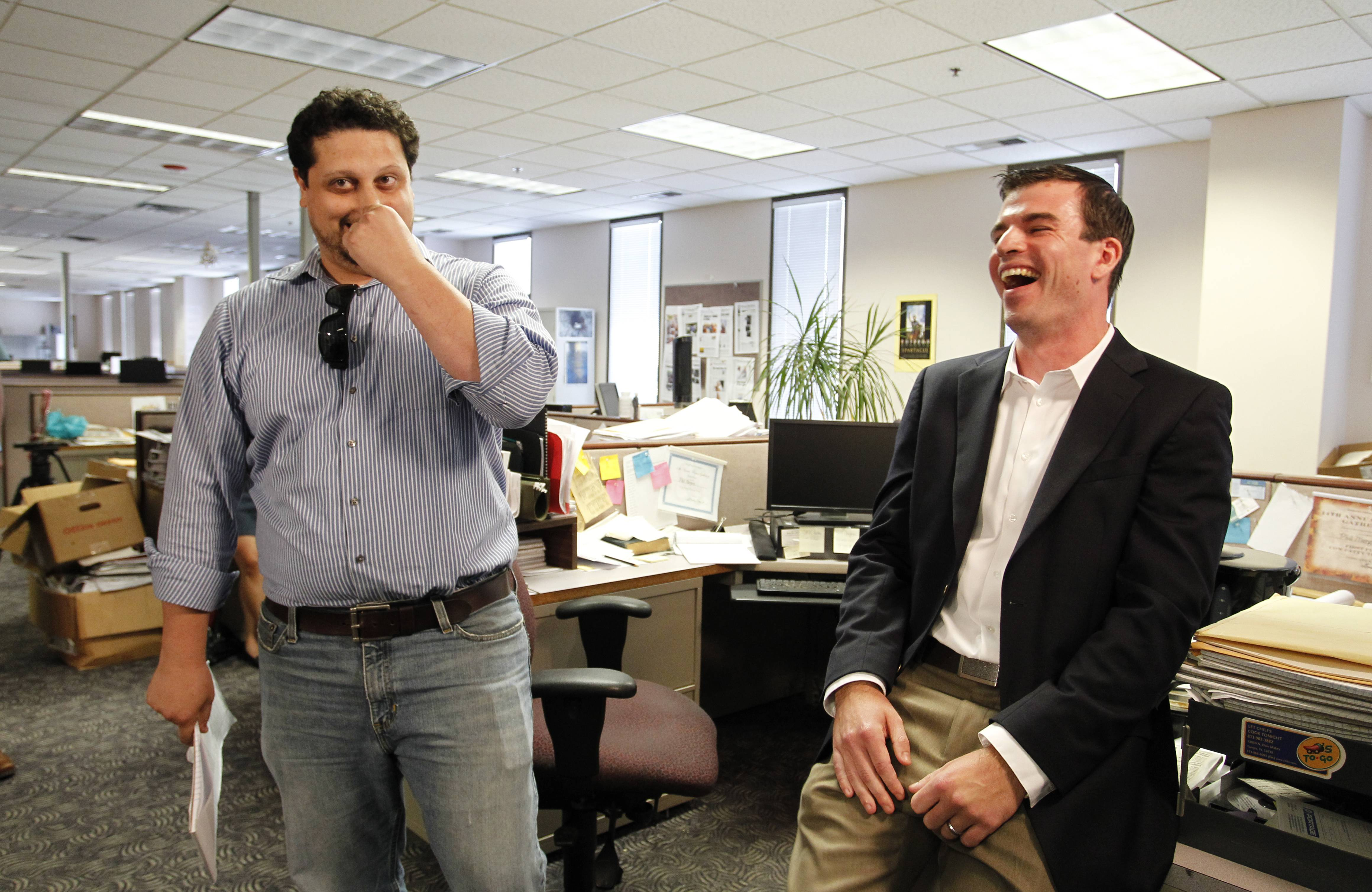 Tampa Bay Times reporters Michael LaForgia, left, and Will Hobson celebrate Monday after hearing they won the 2014 Pulitzer Prize for Local Reporting for writing about the squalid housing for the city's homeless.