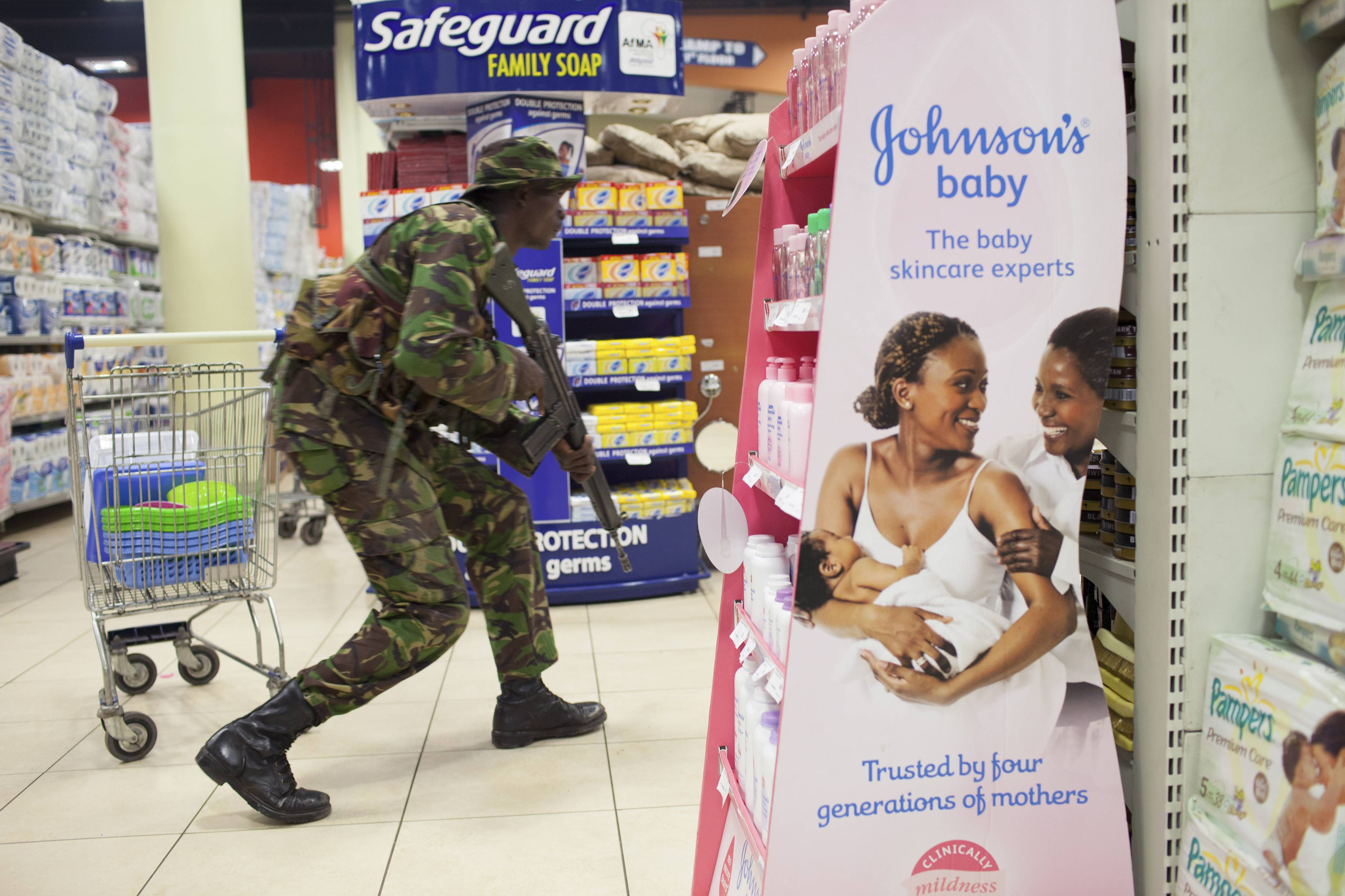 A soldier searches for armed militants who entered the Westgate Mall in Nairobi, Kenya, attacking people at the upscale shopping mall in September. This image was part of New York Times photographer Tyler Hicks' portfolio that was awarded the 2014 Pulitzer Prize for breaking news photography.