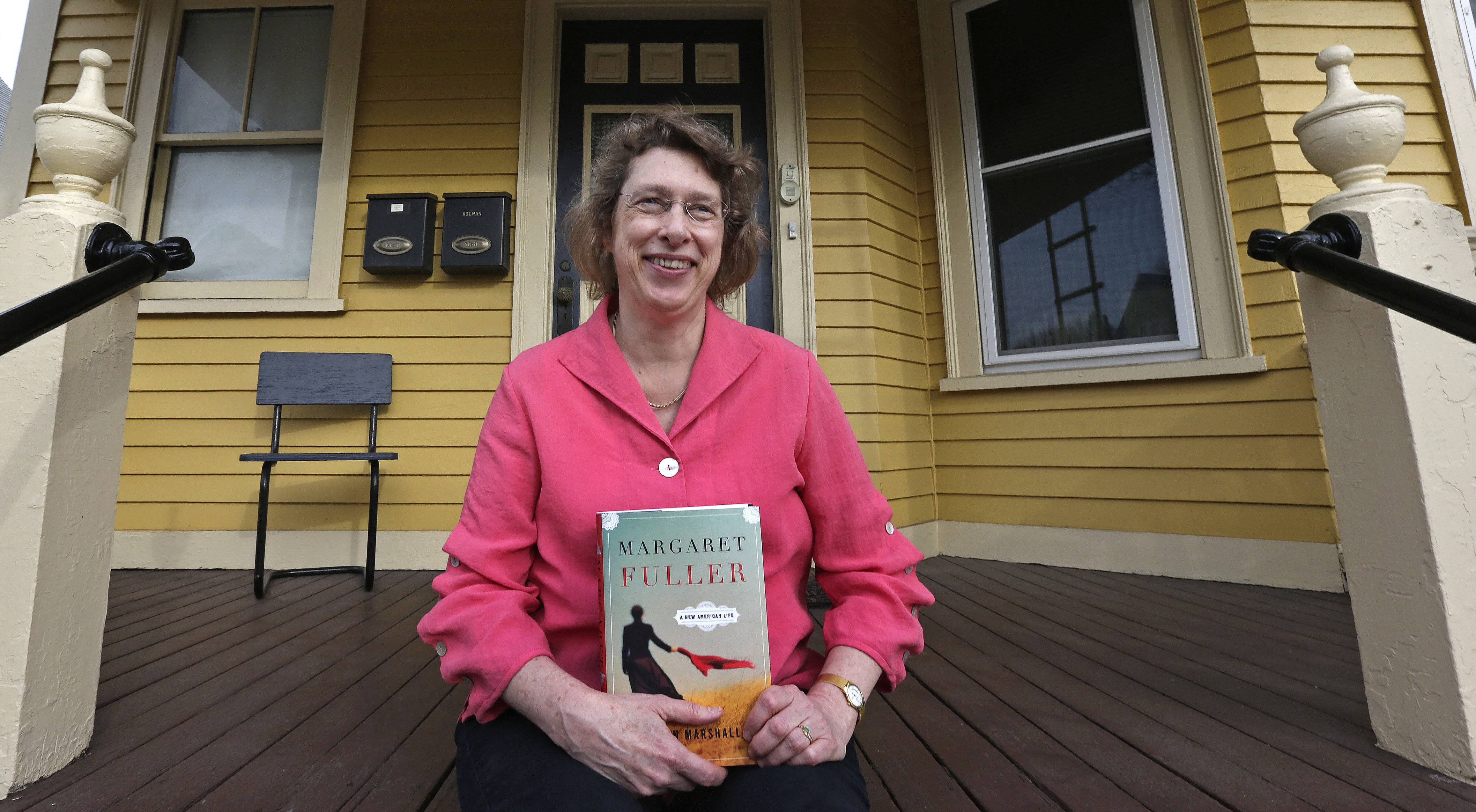 "Author Megan Marshall poses on the front steps of her home in Belmont, Mass., on Monday with her Pulitzer Prize-winning book, ""Margaret Fuller: A New American Life. """