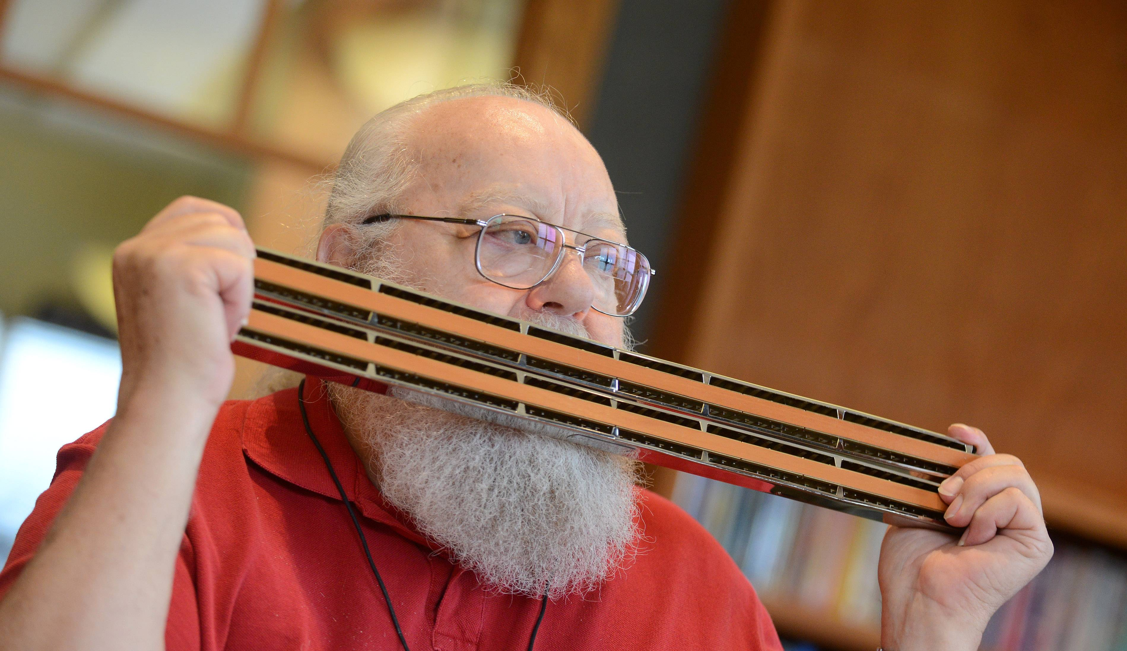 Ray Hagen of Streamwood plays a chord harmonica during Monday's meeting of the Harmelodian Club at Pottawatomie Community Center in St. Charles. The harmonica-playing club is part of the Adult Activity Center run by the park district and has been around about five years.