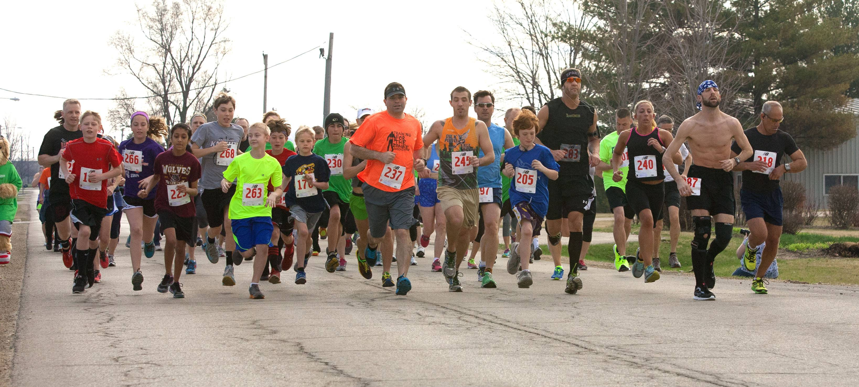 Participants start the 10th annual Dewey Dash race held in downtown Elburn.