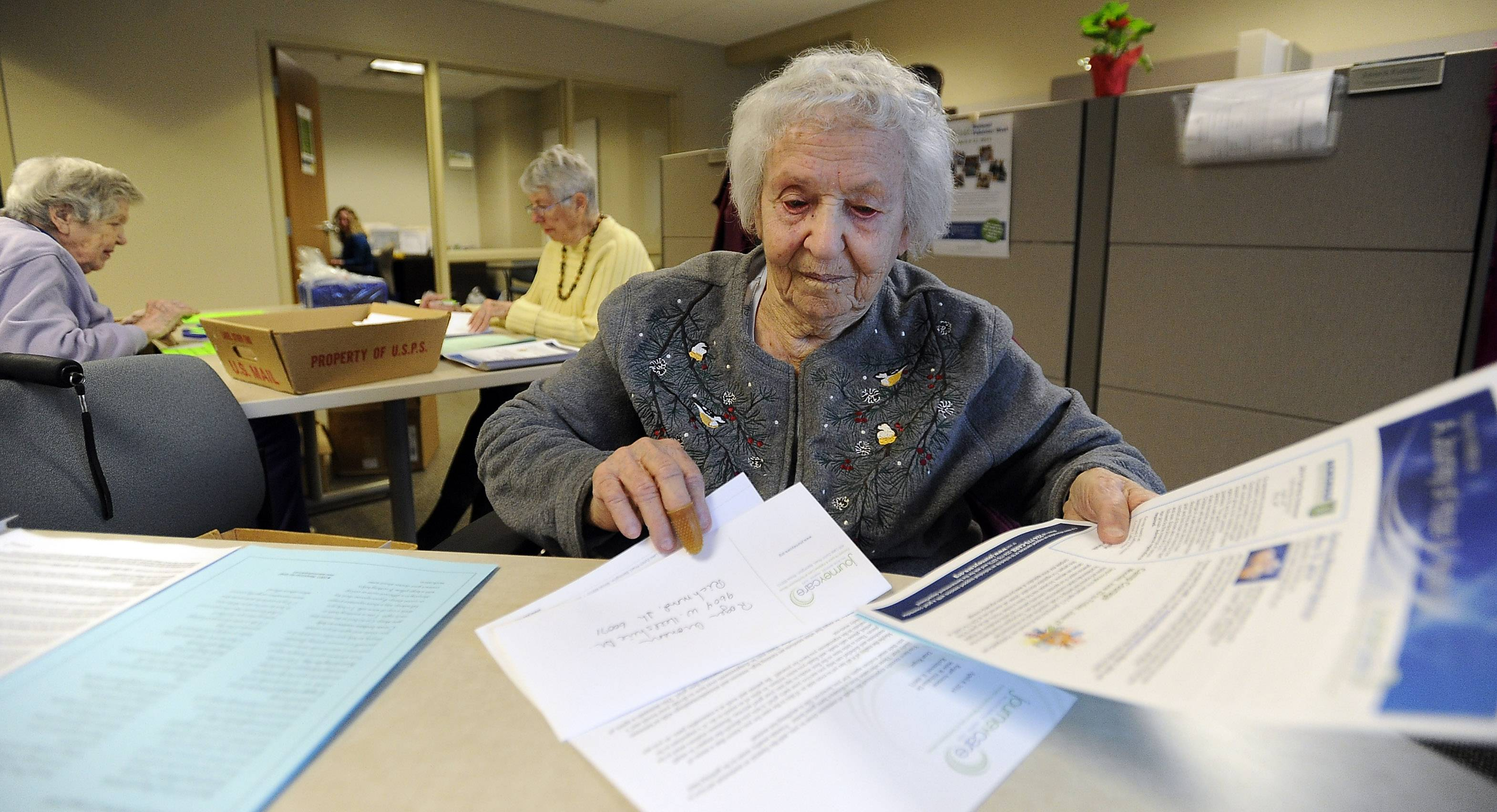 Marie Schaack, a 102-year old volunteer at JourneyCare in Barrington, loves to come to work every day.
