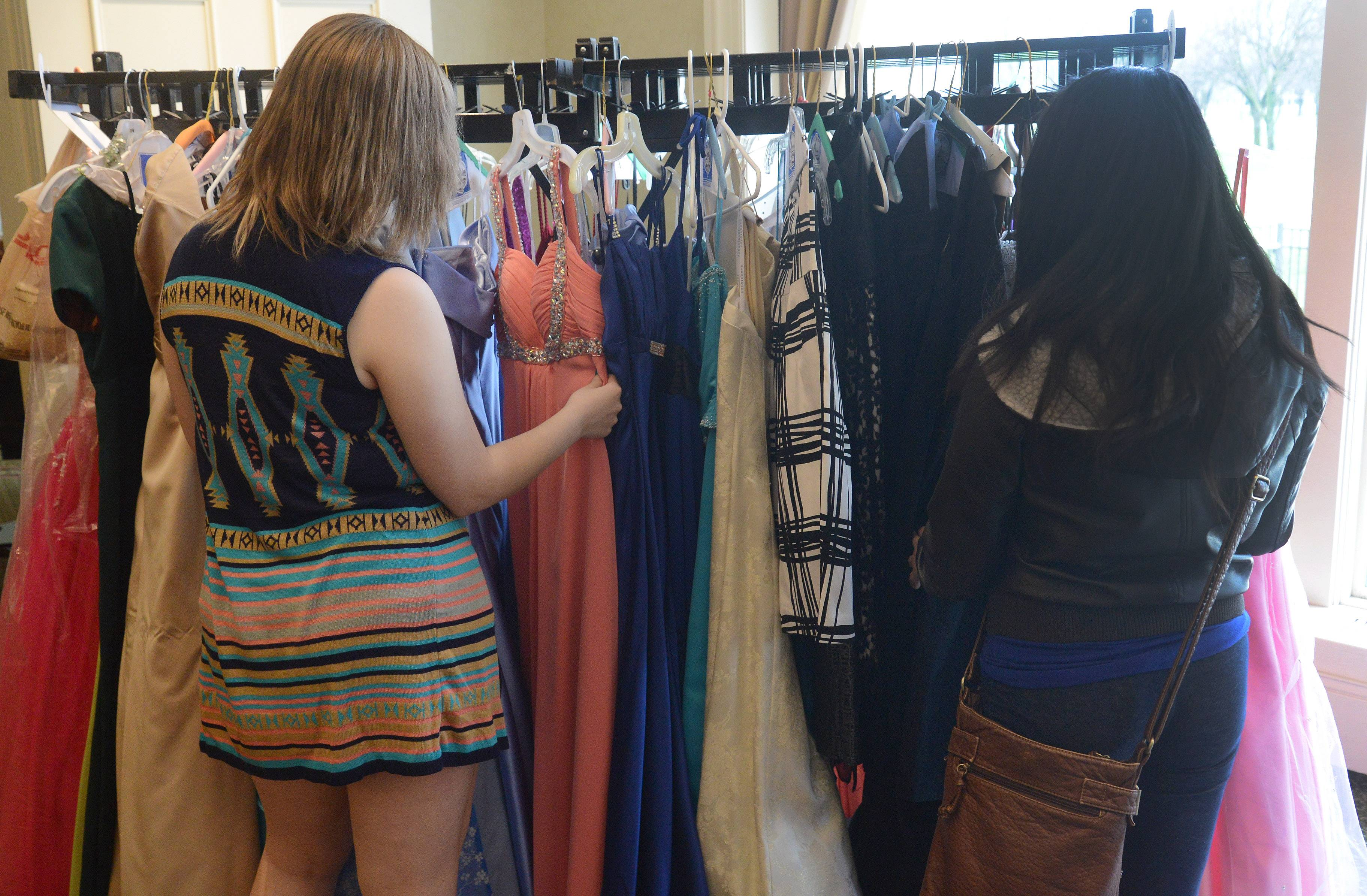 Students from District 214 pick out prom dresses and shoes, collected by the Women's Club at Rolling Green Country Club.