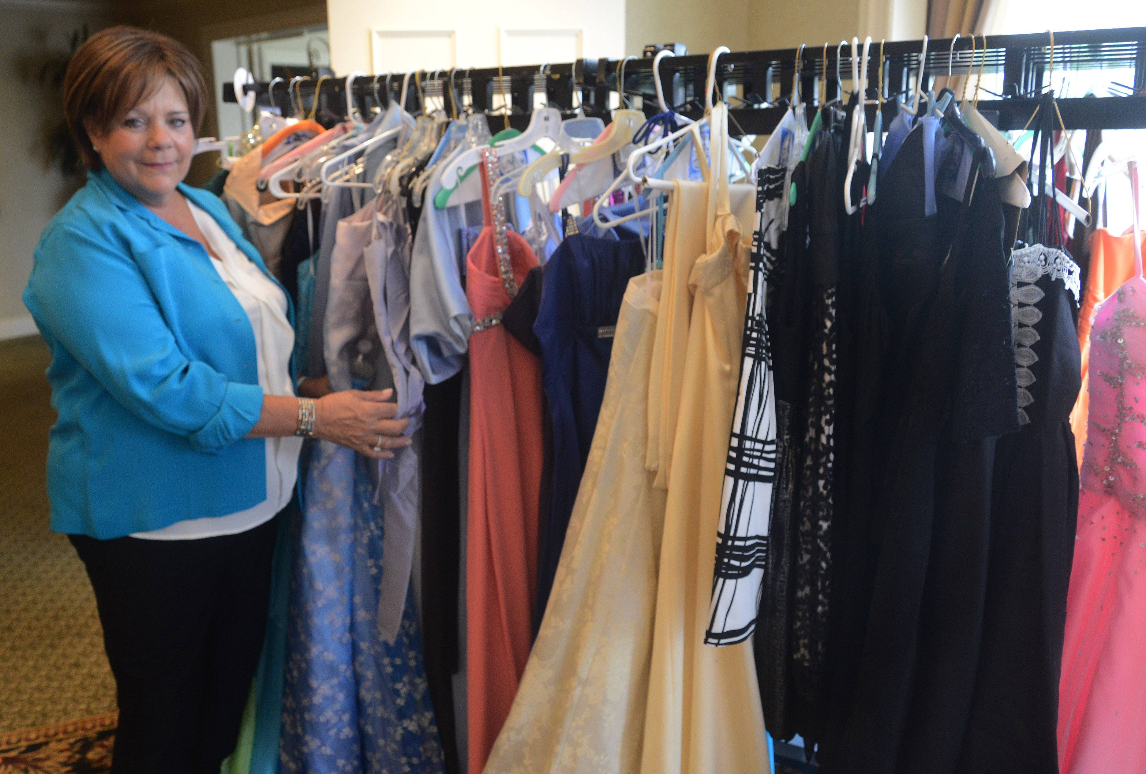 Michaelene Roark, president of the Women's Club of Rolling Green Country Club in Arlington Heights, organized the donation drive, accumulating more than 400 dresses and accessories.