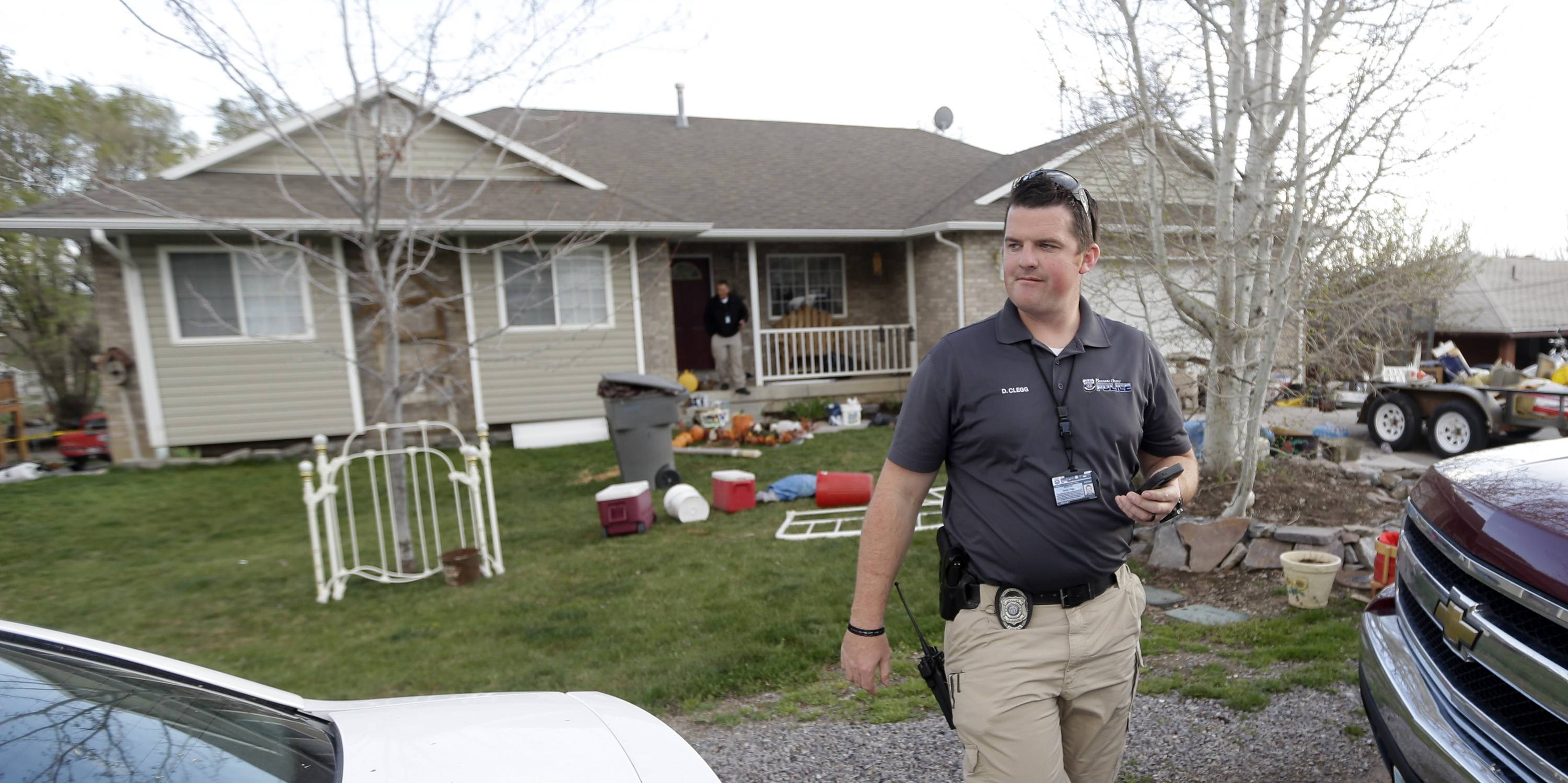 Pleasant Grove Police investigate the scene Sunday where seven infant bodies were discovered and packaged in separate containers at a home in Pleasant Grove, Utah. According to the Pleasant Grove Police Department, seven dead infants were found in the former home of Megan Huntsman, 39. Huntsman was booked into jail on six counts of murder.