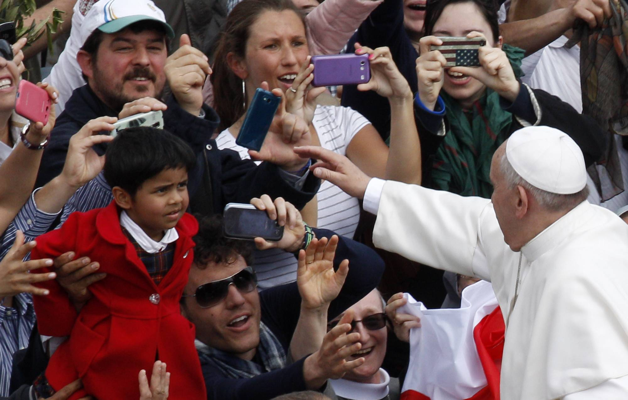 Pope Francis greets faithful at the end of the Palm Sunday Mass in St. Peter's Square at the Vatican on Sunday.
