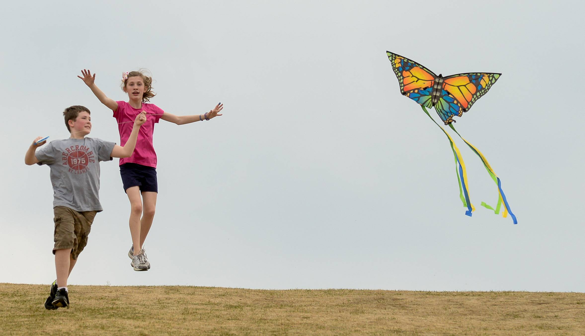Nathan Achziger and his sister Elise, 12, of Wheaton, launch their butterfly shaped kite while taking advantage of light winds and temperatures in the 70s at Northside Park in Wheaton.