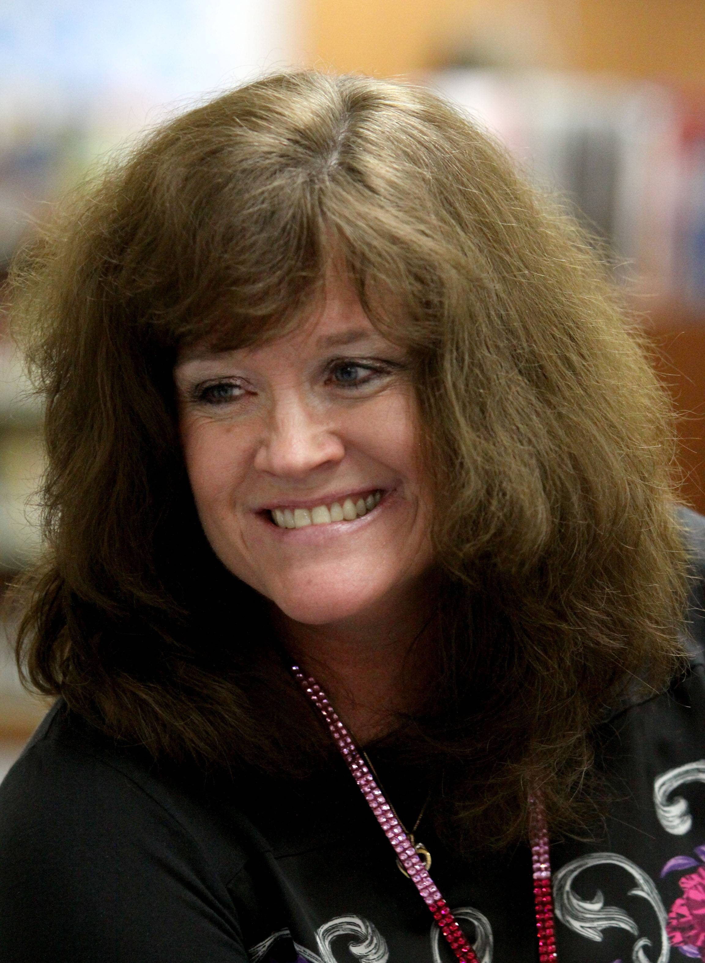 Ask her students and they'll tell you Jeni Rogers loves to joke about her hair. And she has lots and lots and lots of it.