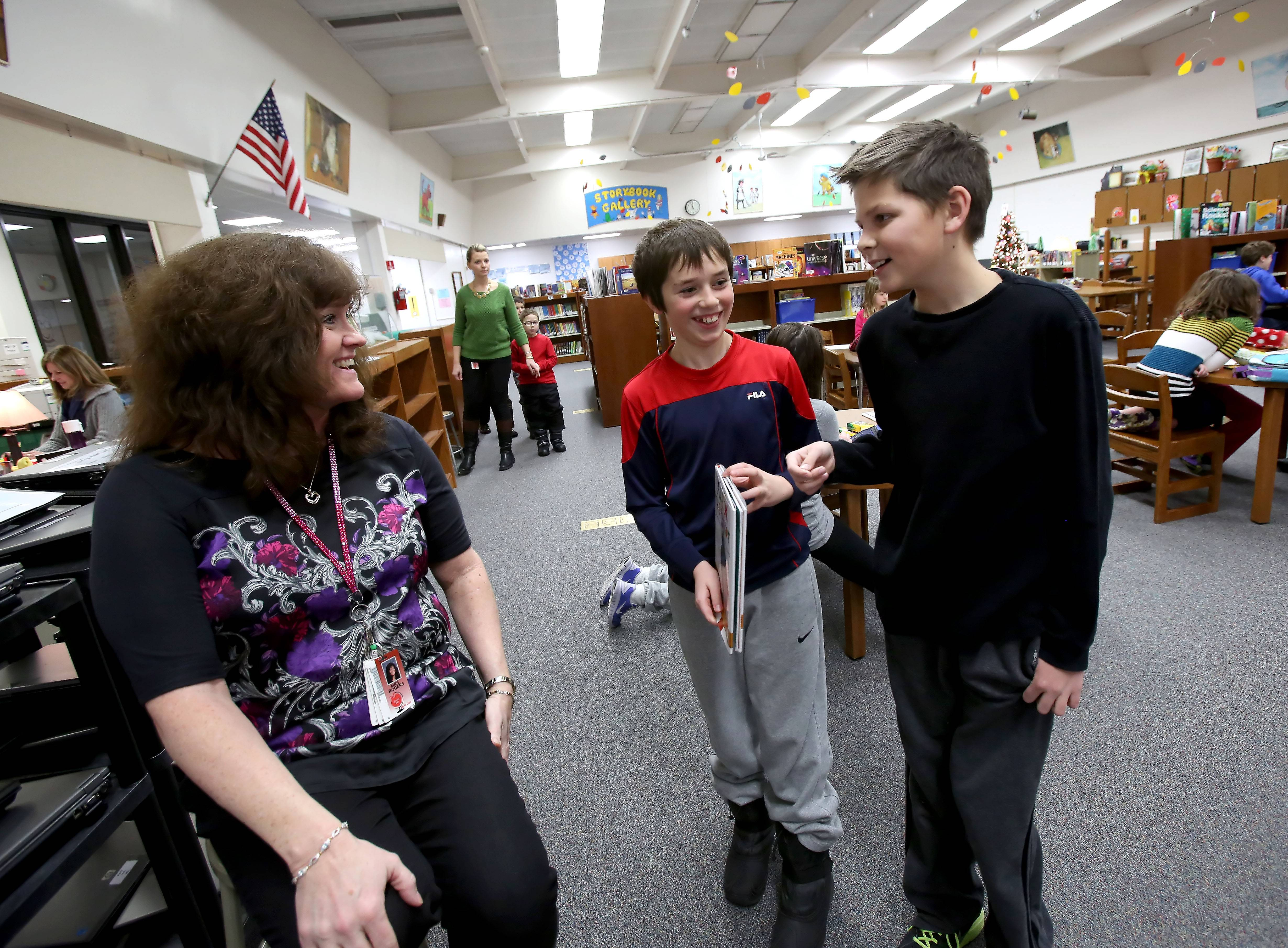 "Callum Galpin, center, and Lucas Montanari talk with teacher Jeni Rogers. Rogers says she works hard to build individual relationships with each student. ""I always say they have to think that you care before they care what you think,"" she says."