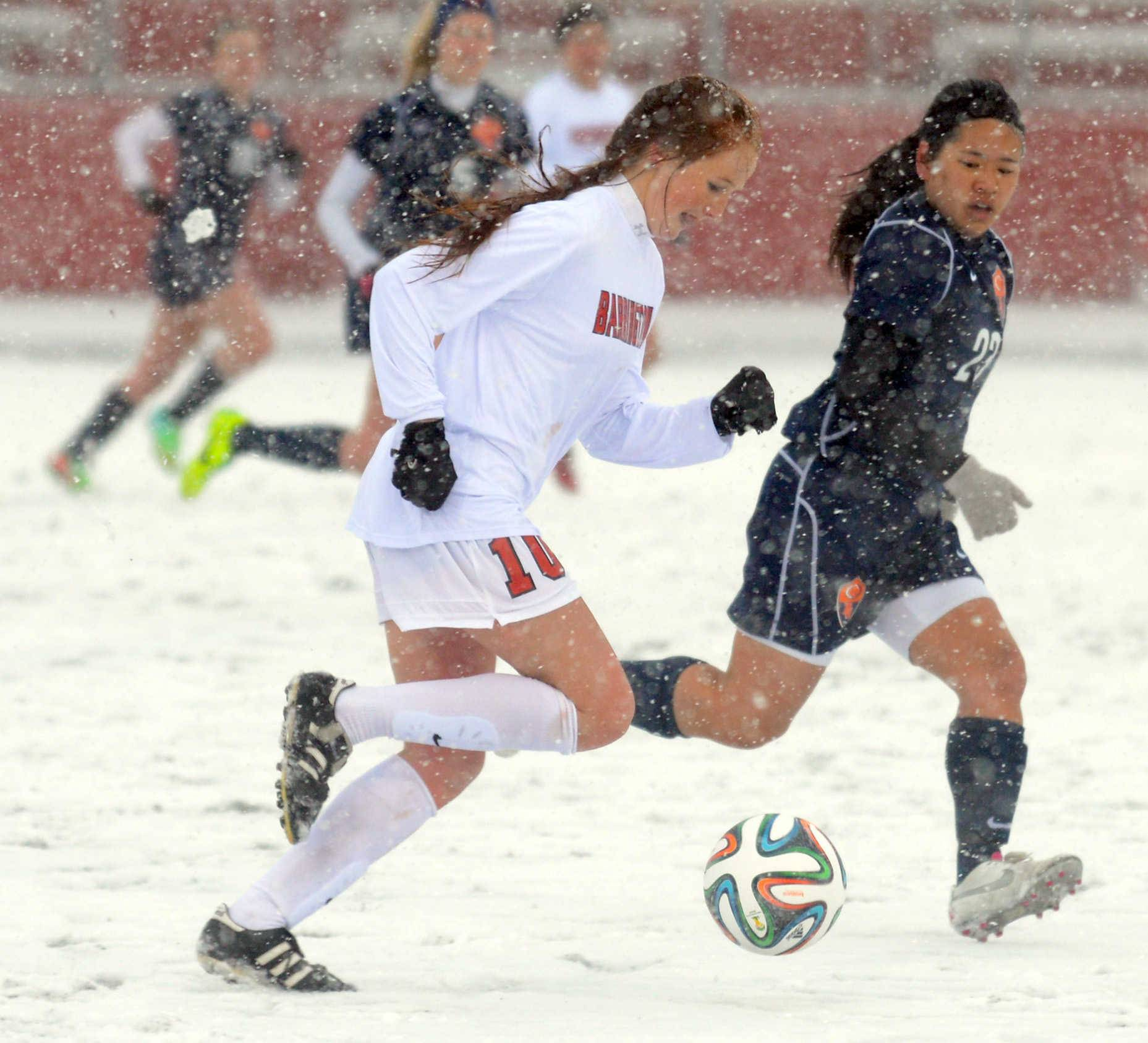 Barrington's Carrie Madden, left, moves the ball as Buffalo Grove's Elizabeth Chan defends Monday at Barrington.