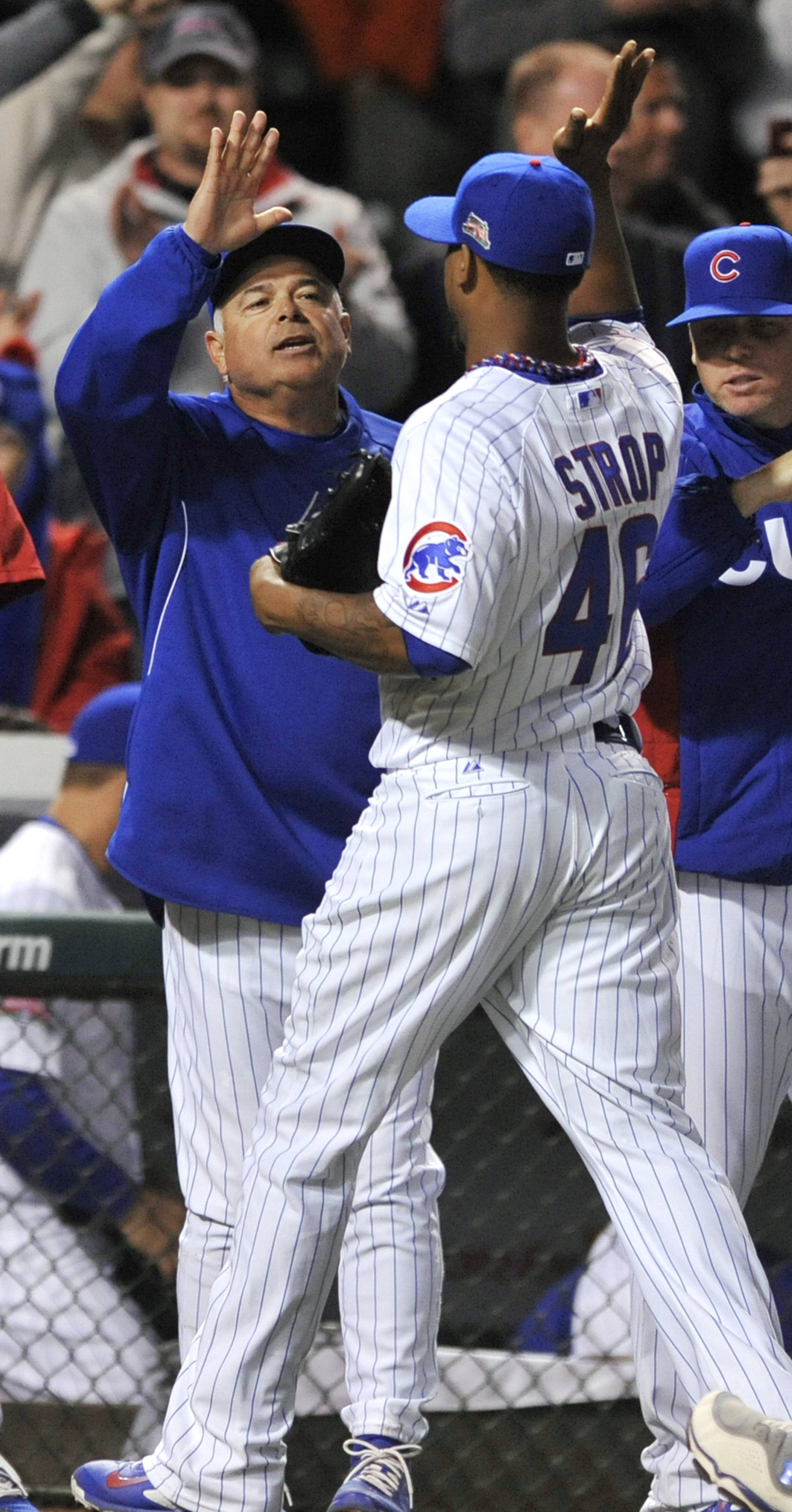 Pedro Strop gets congratulations from Cubs manager Rick Renteria after earning a save against the Pirates on April 9. Beat writer Bruce Miles thinks the Cubs should abandon conventional baseball wisdom and utilize a different approach to the closer's role.