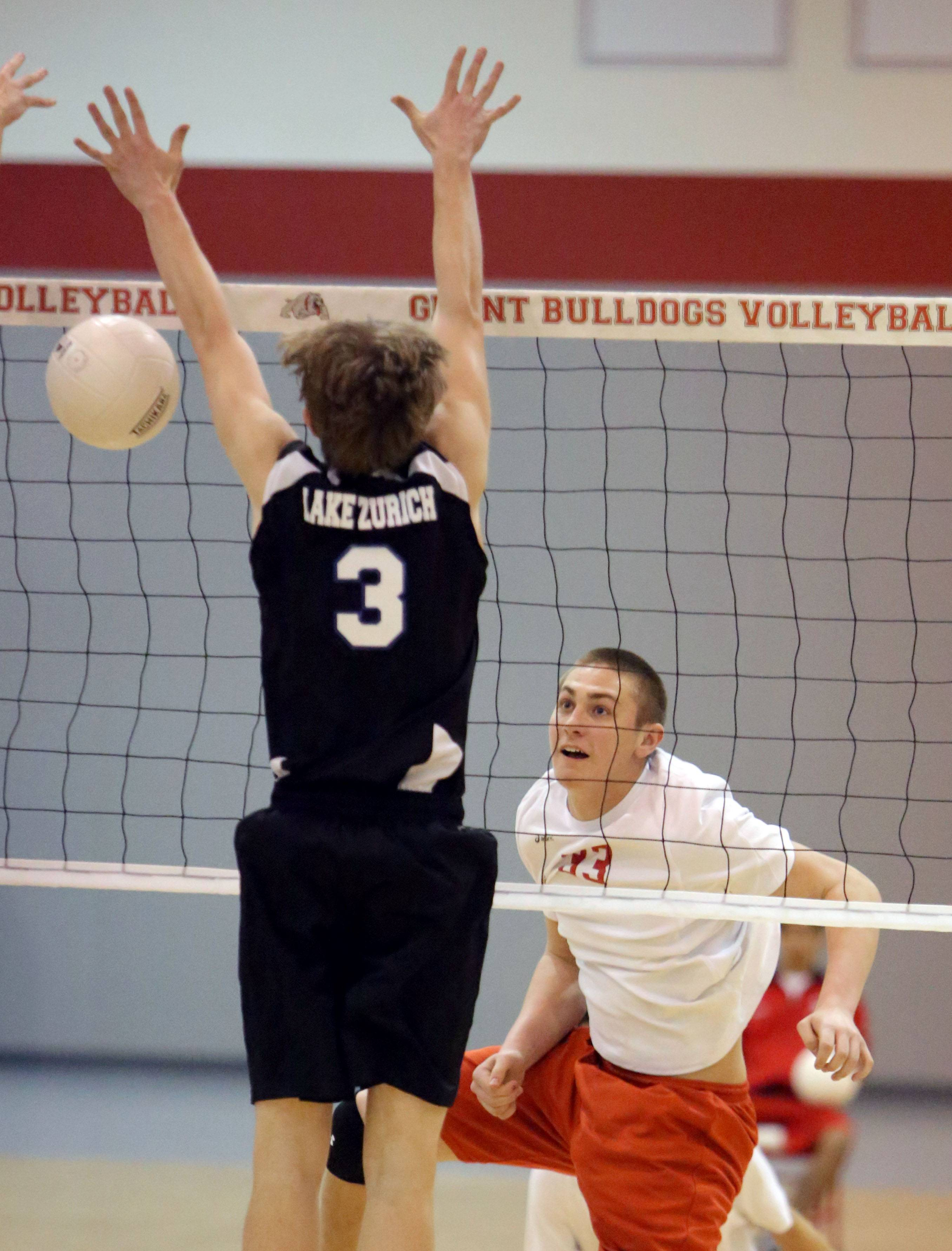 Grant's Brock Lundman, right, goes on the attack against Lake Zurich's Pat Bush on Monday at Grant.