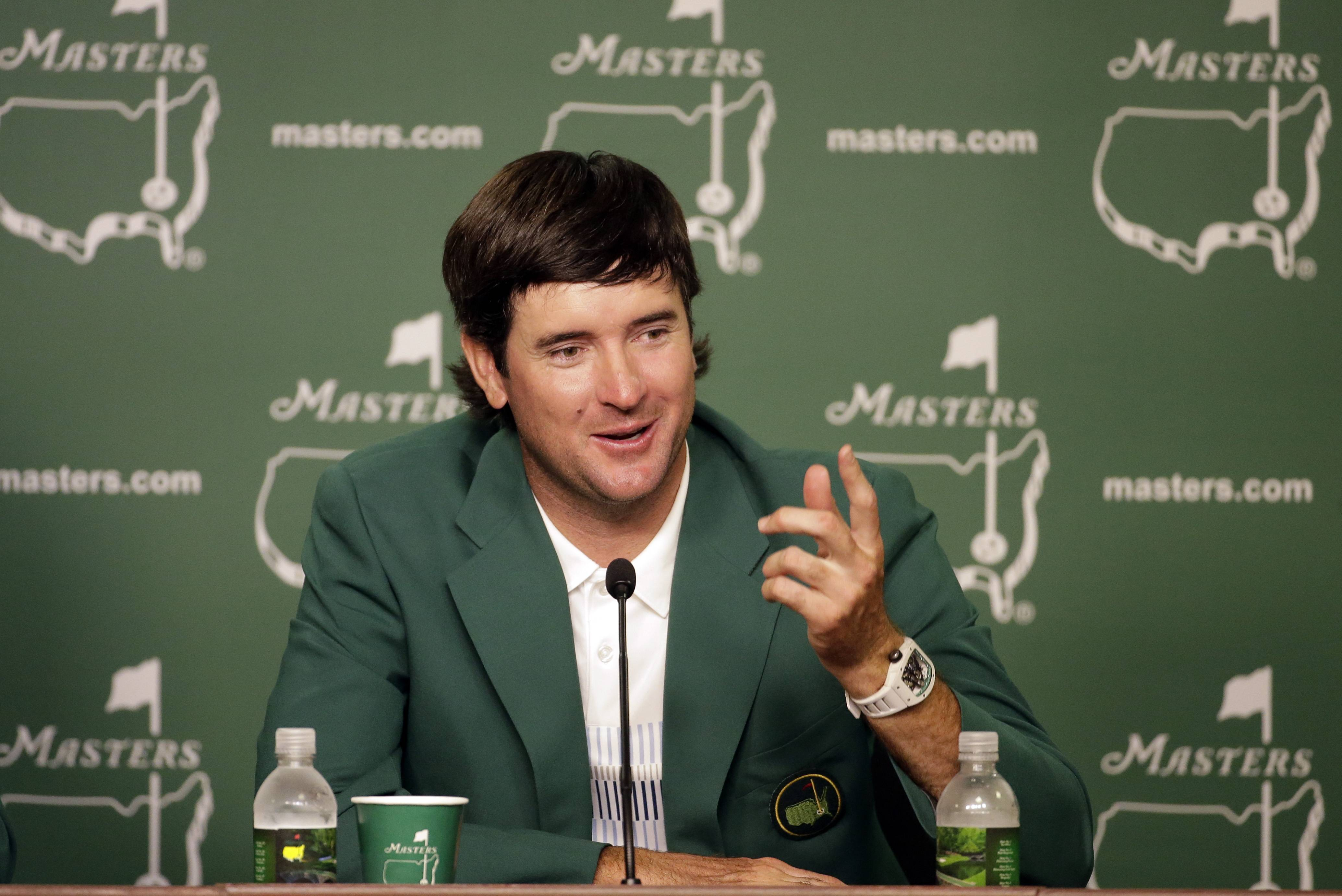 Bubba Watson, speaks during a press conference wearing his green jacket after winning the Masters golf tournament Sunday in Augusta, Ga.