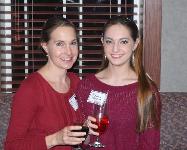 Cathy Blythe of Libertyville, left, with daughter Sarah, celebrates Cathy's Outstanding Service Award.