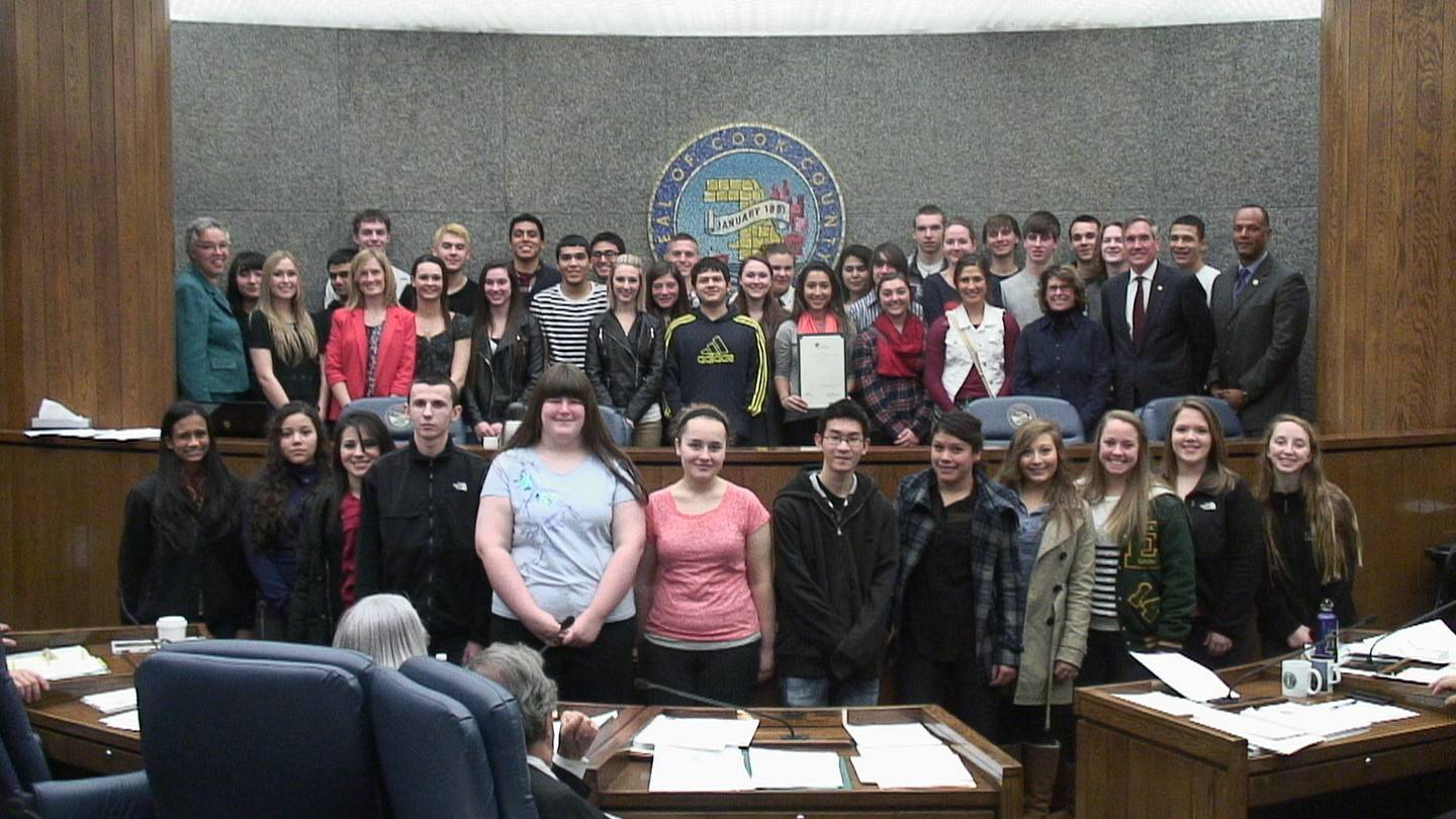 Elk Grove High School's AP Environmental Science students are flanked by (left) Cook County Board President Toni Preckwinkle, teacher Krista Glosson (pink jacket), and (far right) District 214 board member Alva Kreutzer, 15th District Cook County Commissioner Timothy Schneider and General Superintendent Arnold Randall.