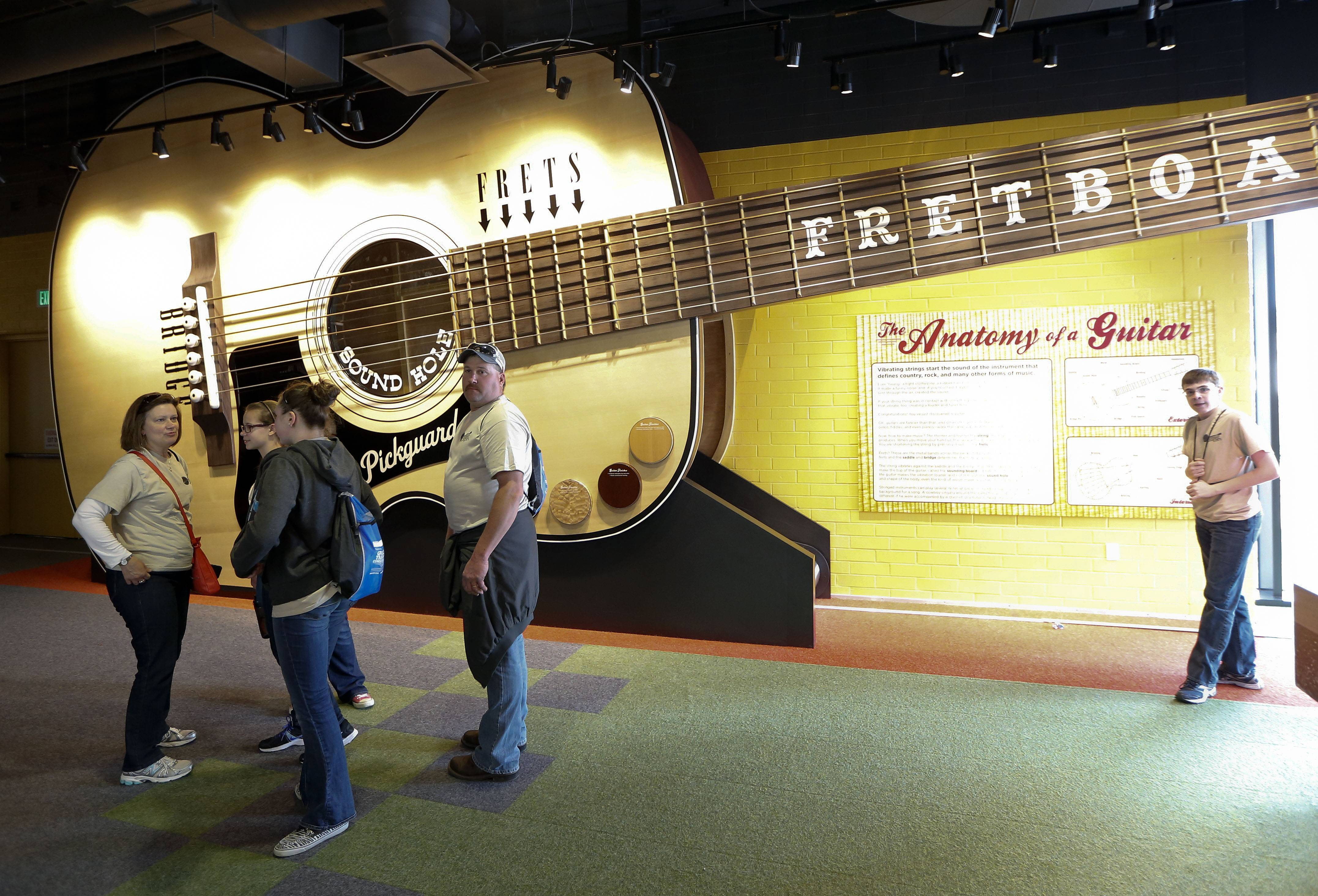 A 52-foot replica of an acoustic guitar is part of a new section of the Country Music Hall of Fame and Museum in Nashville, Tenn. Educational exhibits are part of the $100 million expansion.