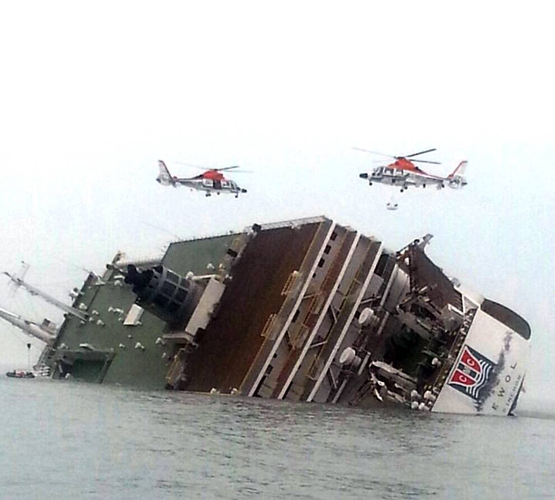 South Korean rescue helicopters fly over a South Korean passenger ship, trying to rescue passengers from the ship in water off the southern coast in South Korea, Wednesday. The South Korean passenger ship carrying more than 470 people, including many high school students, was sinking off the country's southern coast today after sending a distress call, officials said.