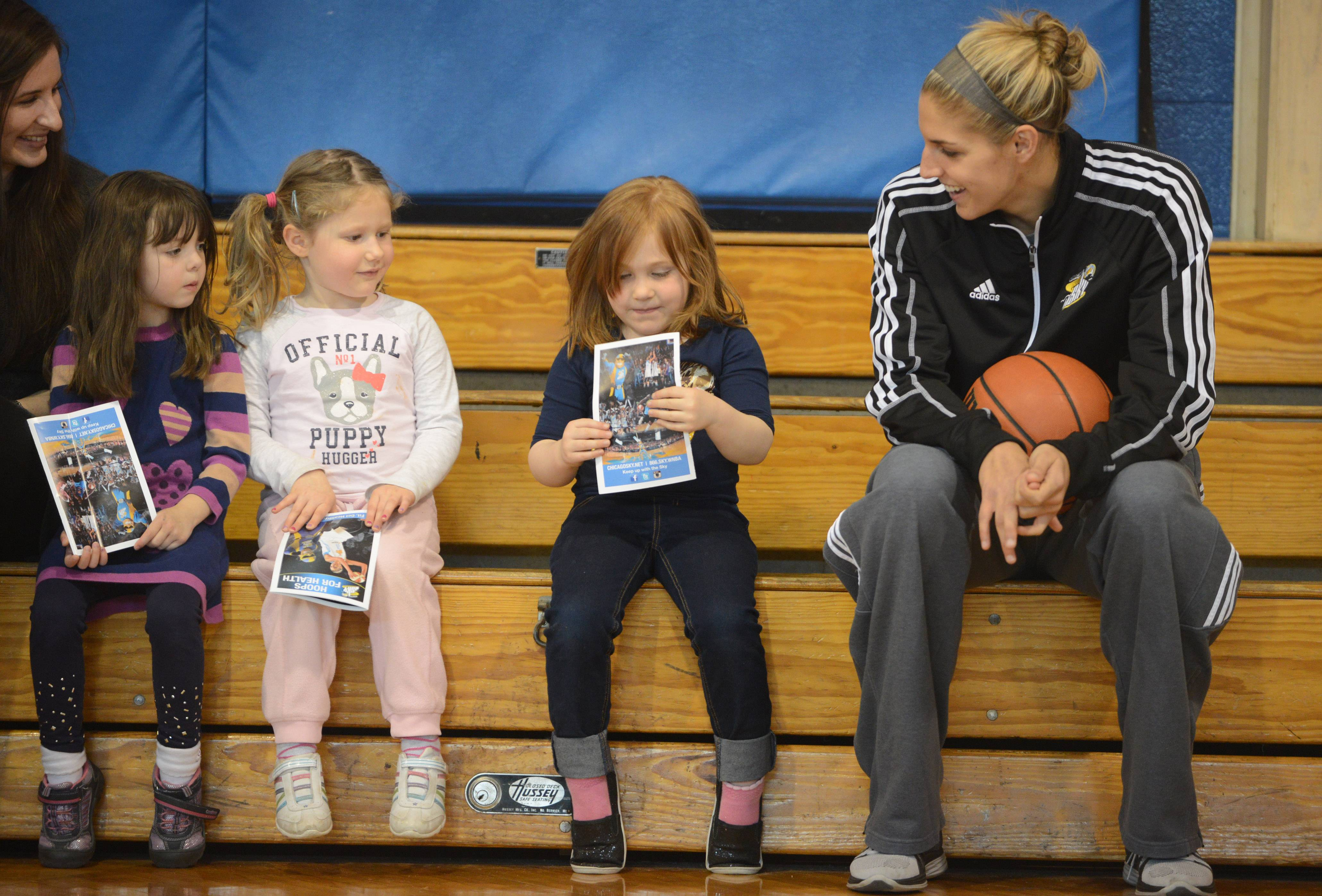 Chicago Sky player Elena Delle Donne, right, talks with St. Matthew preschool students from Emily Horbus, left, Caitlin Ruley and Sophia Krueger at the start of Tuesday's Hoops for Health program in Hawthorn Woods.