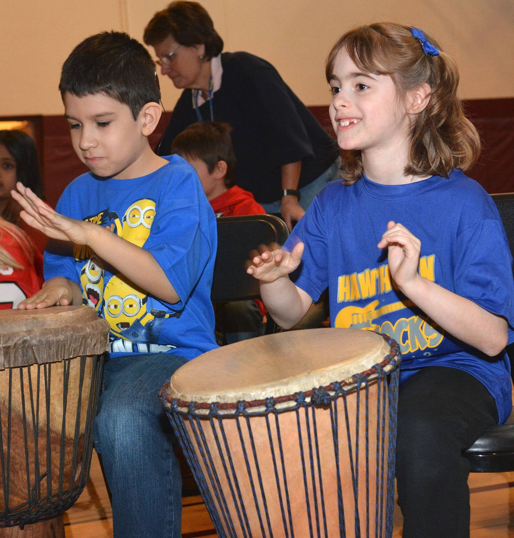 Townline Elementary School students Tony Segrero and Abigail Weiner play dununs, West African drums, as part of an Artful Learning in Action program. District 73 hopes that connecting the fine arts to learning will help students develop into analytical thinkers and team players, with higher academic achievement and an appreciation for cultural diversity.