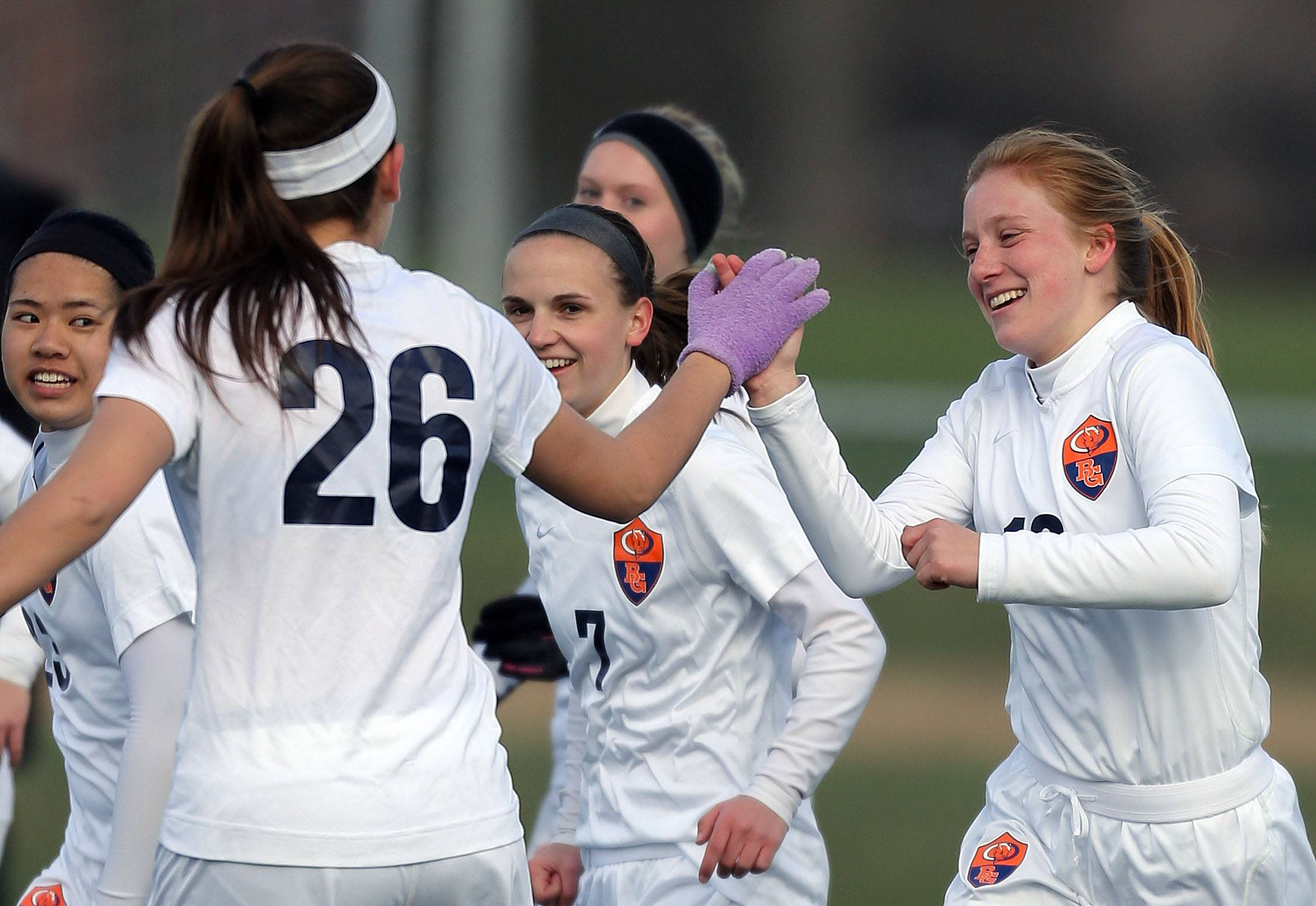 Buffalo Grove's Allie Ingham, left, high-fives Kelli Zickert after her goal in the first half during their game against Warren on Tuesday at Buffalo Grove.