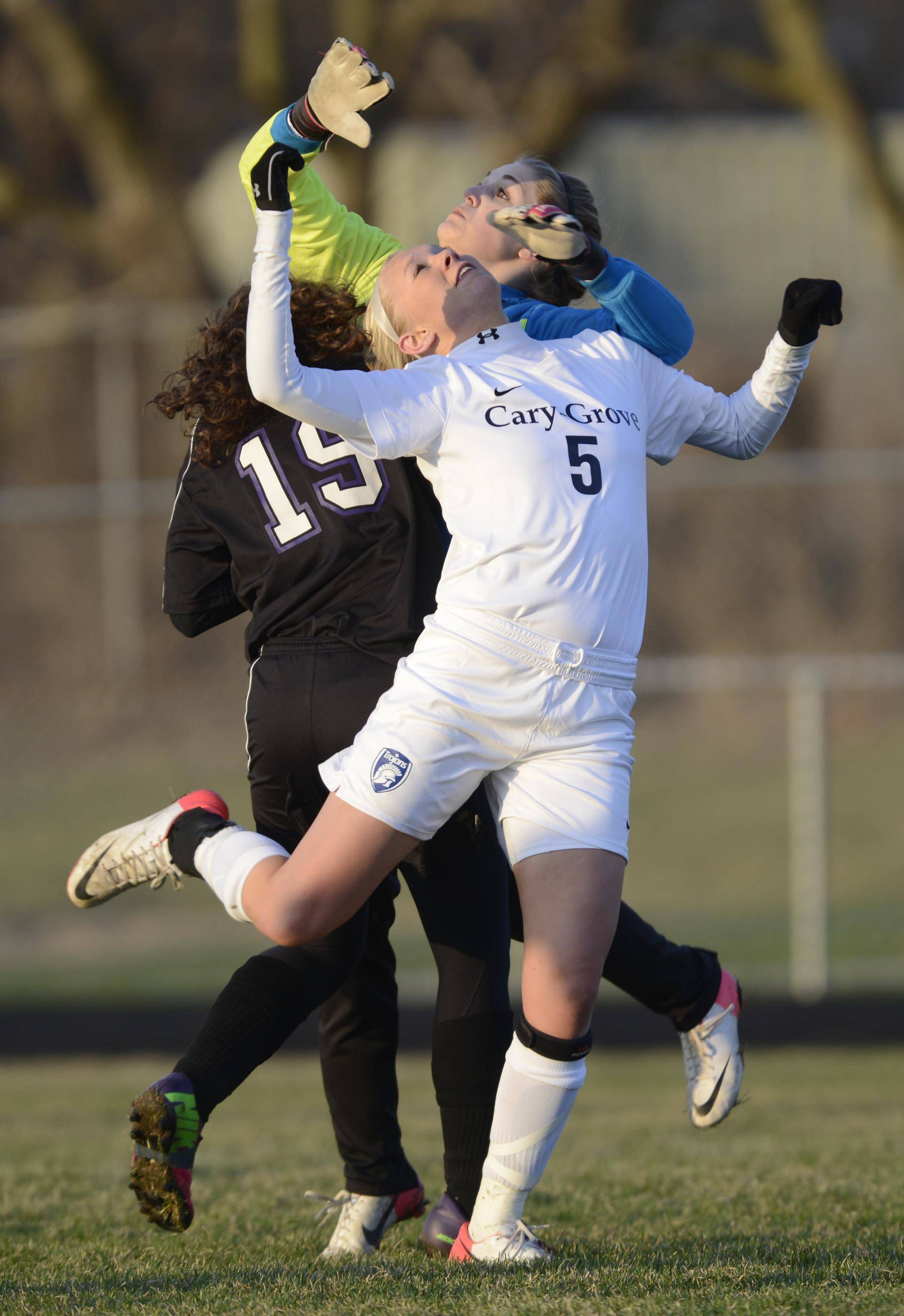 Cary-Grove's Carli Petersen collides with Hampshire goalkeeper Catherine Kochanski Tuesday in Cary. Petersen had two goals in the first half.