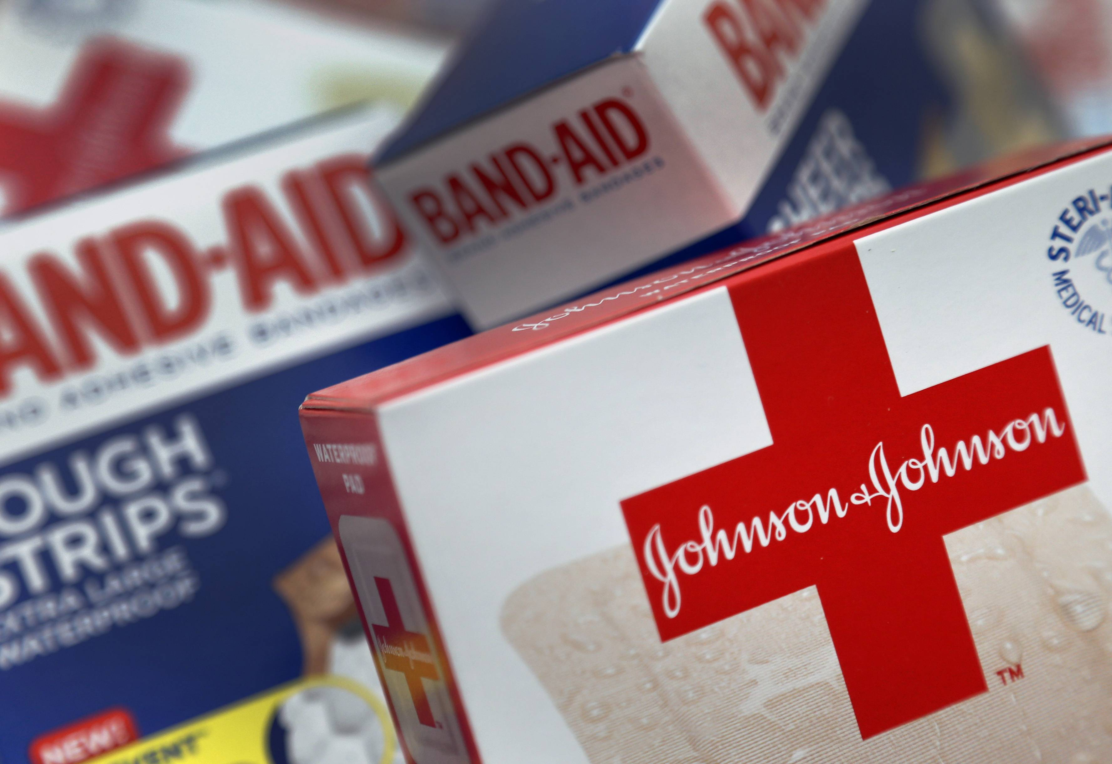 Johnson & Johnson's first-quarter profit rose 8 percent, because of restrained costs and a big jump in prescription drug sales. The world's biggest maker of health care products easily beat Wall Street expectations and raised its earnings outlook, driving up its shares to a new high for the year.