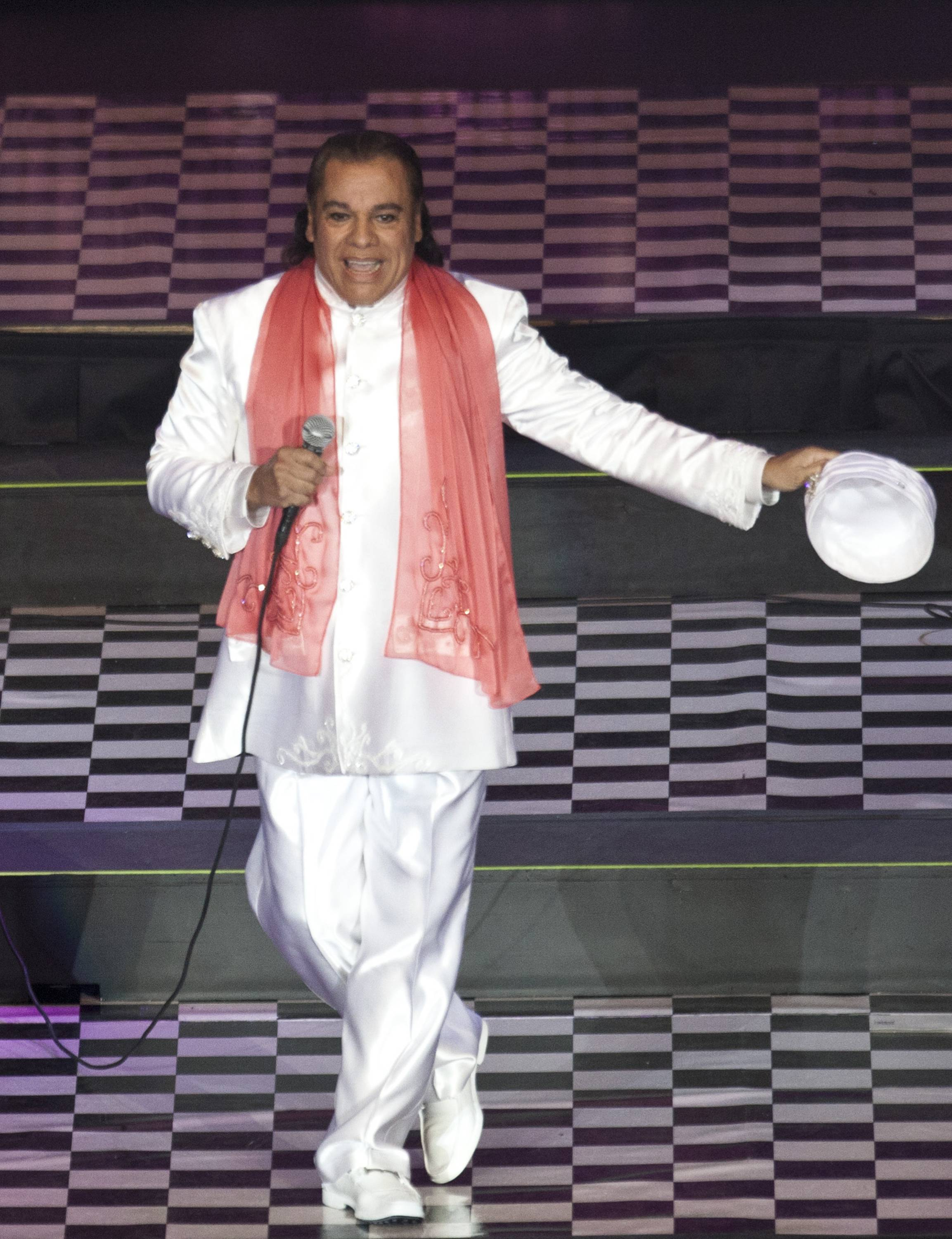 Juan Gabriel has postponed three California shows after being hospitalized in Las Vegas with pneumonia.