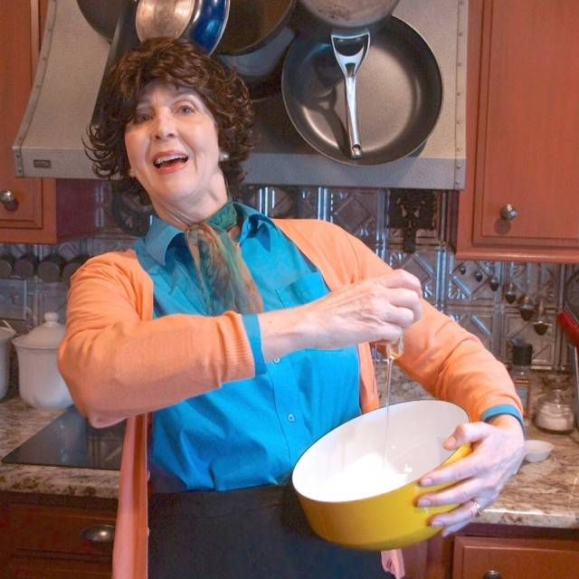 Storyteller Lynn Rymarz performs as Julia Child April 27 in Lincolnshire.